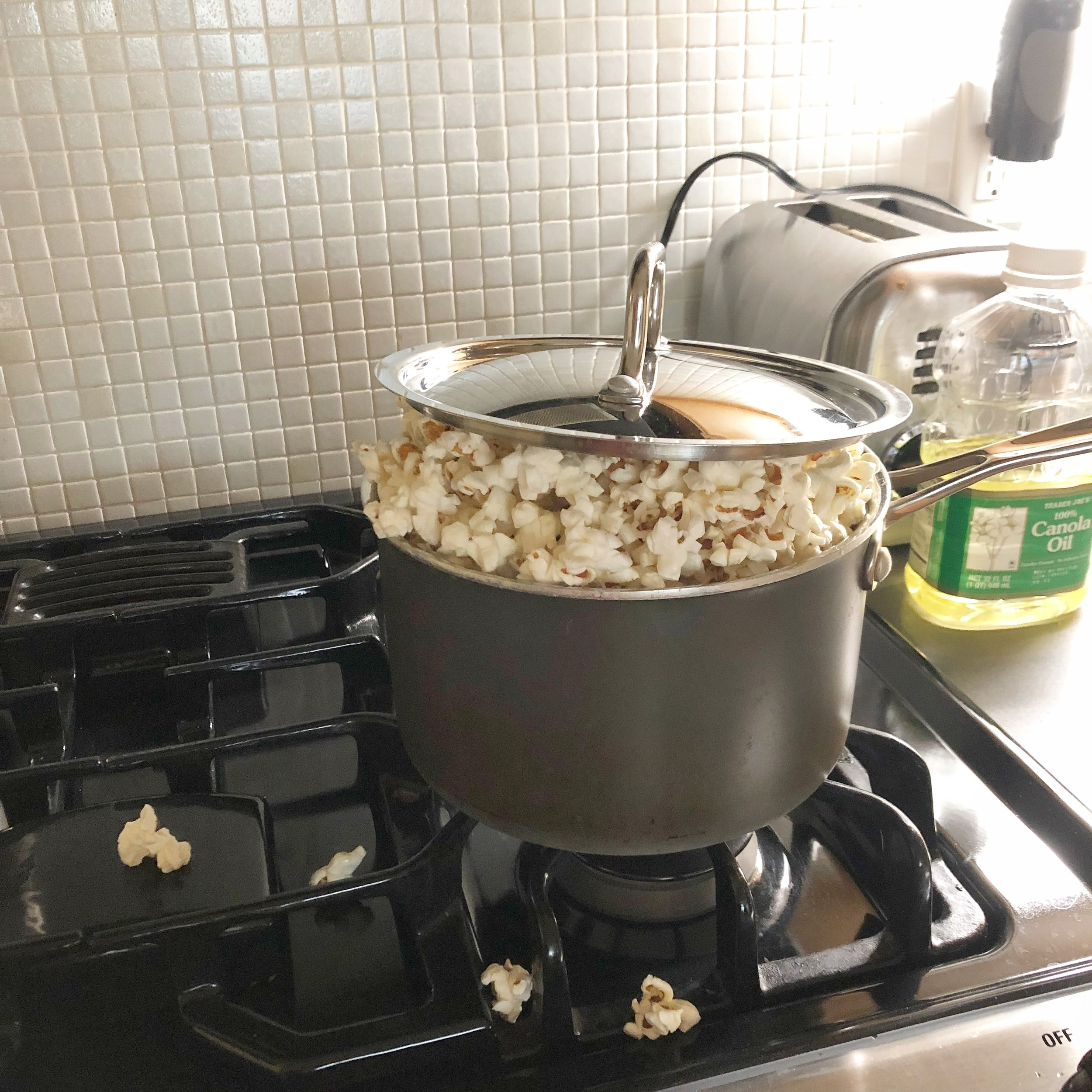 As soon as you hear popping, shake the pan continuously and vigorously over the heat until the popping sound subsides.