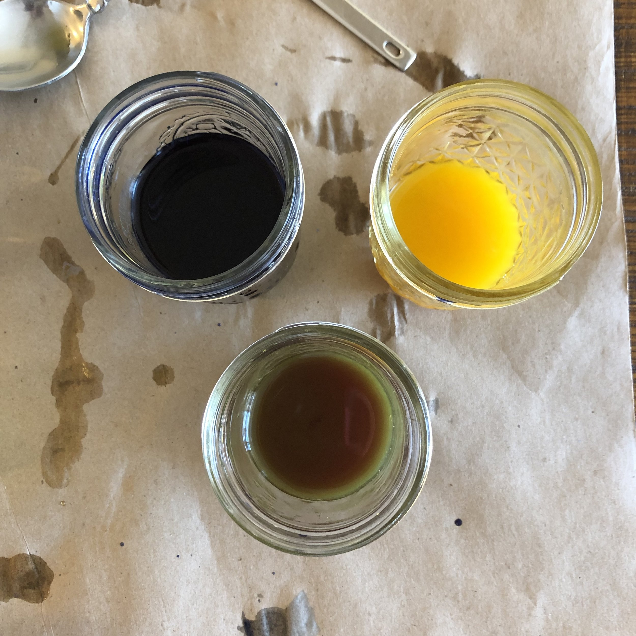 Top left: blue butterfly pea flower dye; Top right: yellow turmeric root dye; Bottom: Green dye made from combining