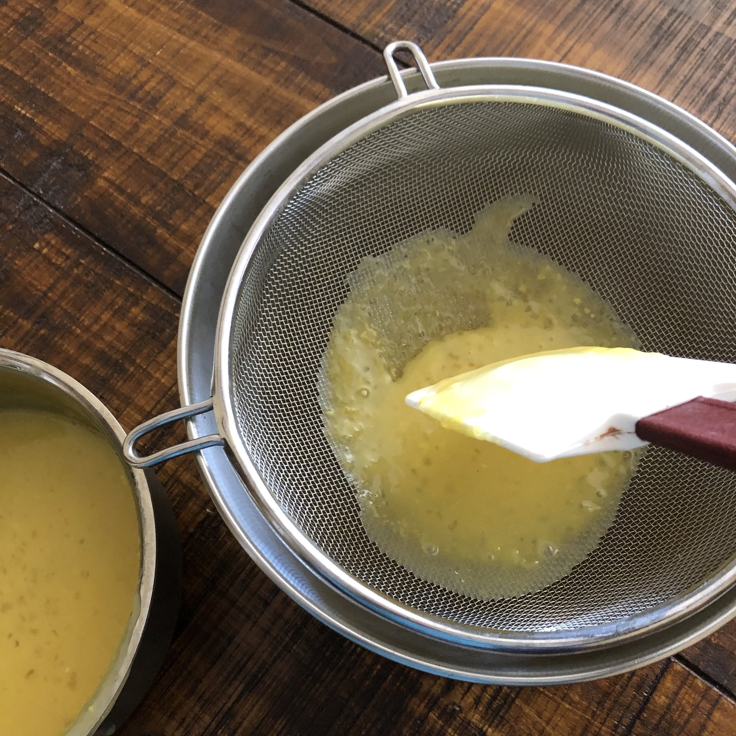 Strain the liquid through a mess strainer to remove any tapioca lumps, eggs bits, and large pieces of lemon zest. Use a rubber spatula to gently press it through.