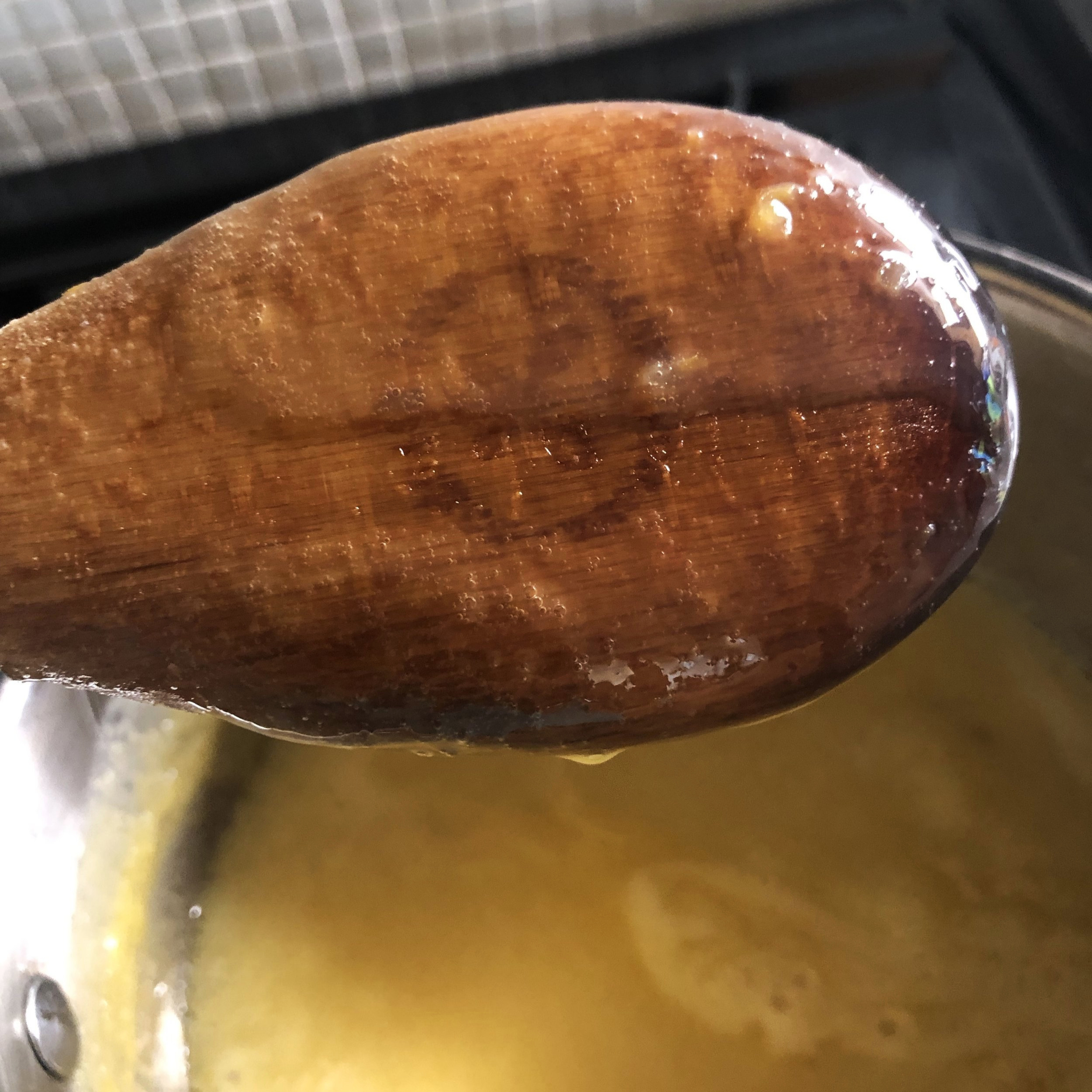 No thermometer? No problem. Check custard by coating the back of a wooden spoon. Run your finger through it. If the line holds for at least 10 seconds, it's done.