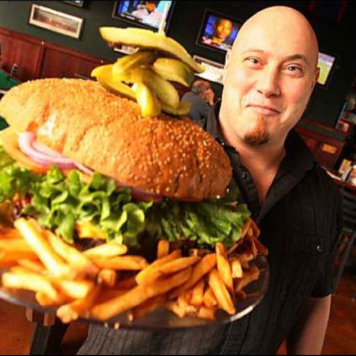 Owner, Steve Mallie Presenting the Ten Pound Burger, 2007.