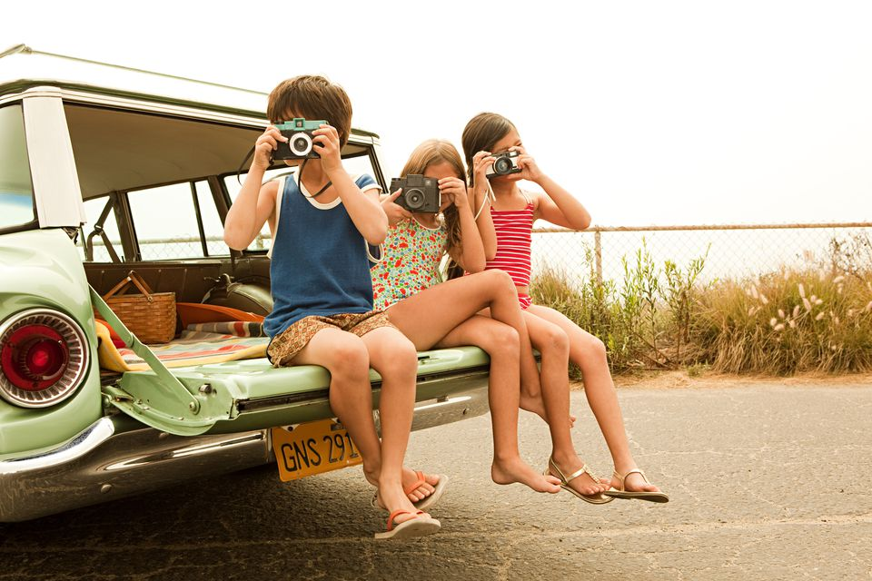 three-children-sitting-on-back-of-estate-car-taking-photographs-109434204-58f549a65f9b581d59ea5781.jpg