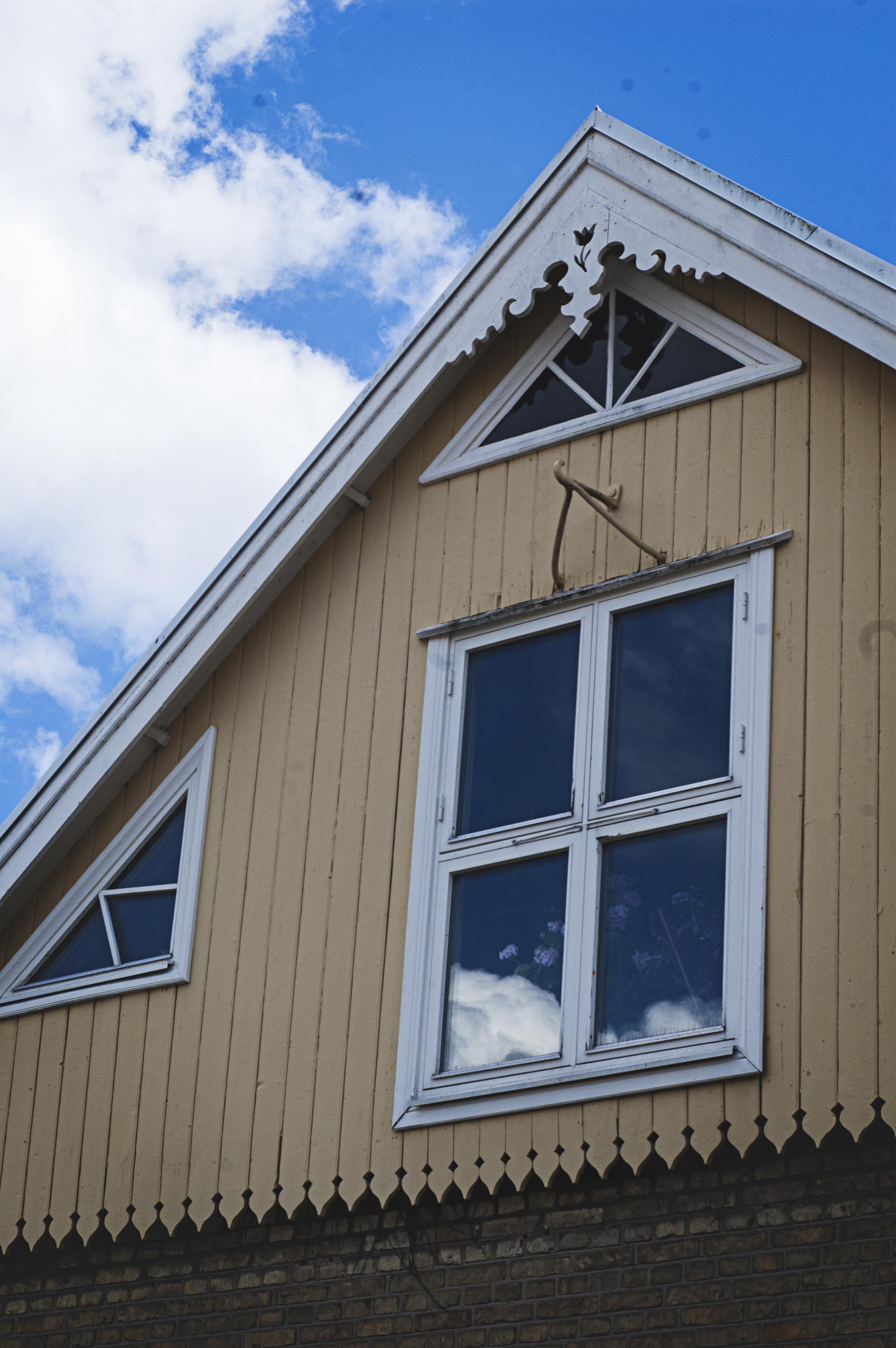 Afternoon Fika among the hollyhocks, Kivik