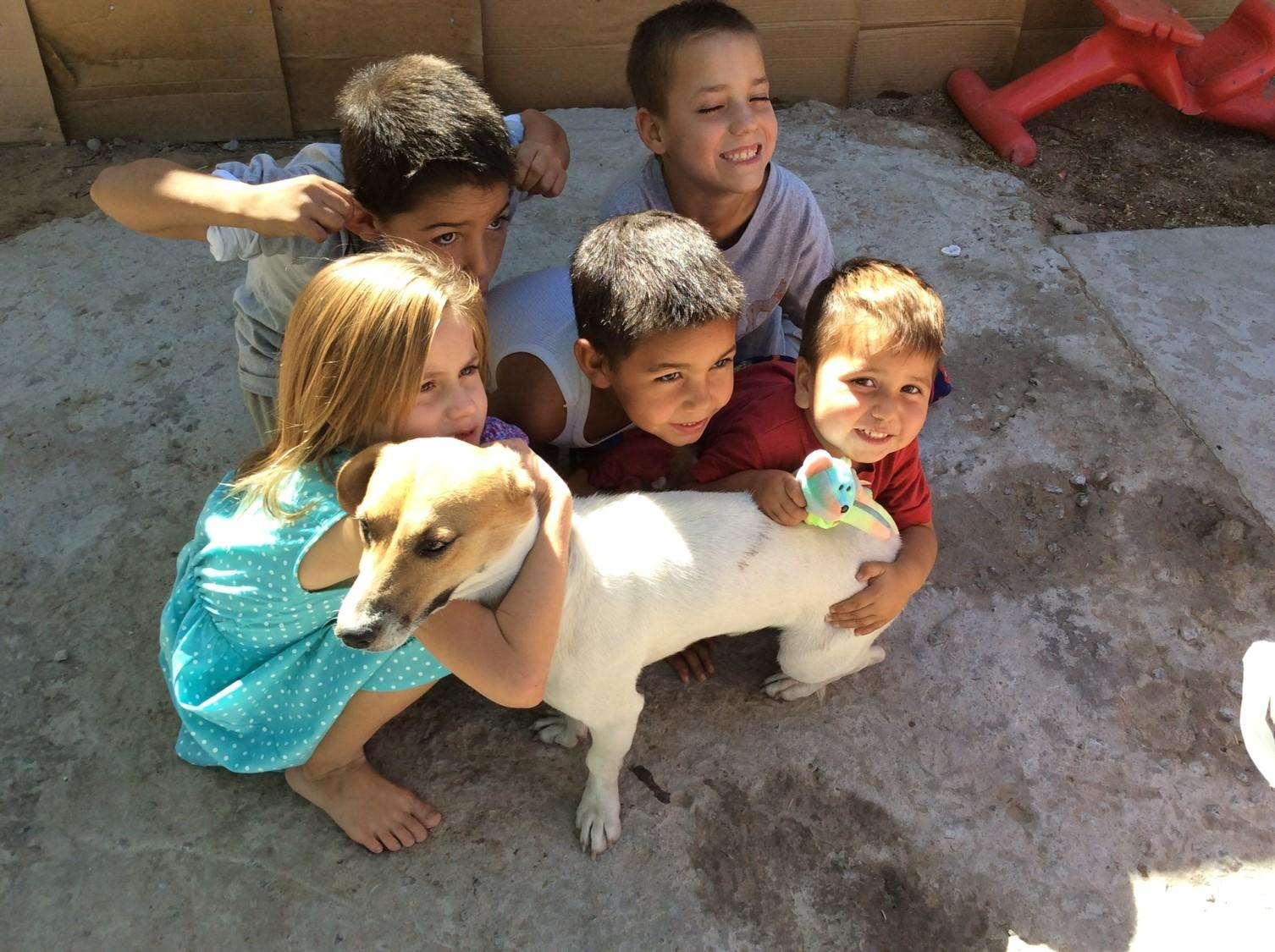 Rosas grandchildren with dog.jpg