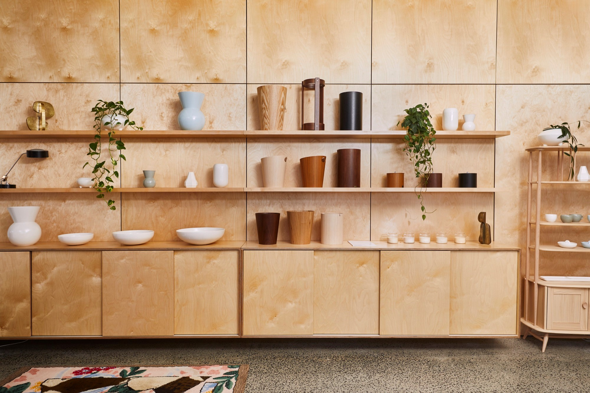 Ceramics and sculptures from Gidon Bing are displayed next to iconic plywood homeware from Japanese company Saito. The hand tufted rug is from Christchurch maker Dilana.