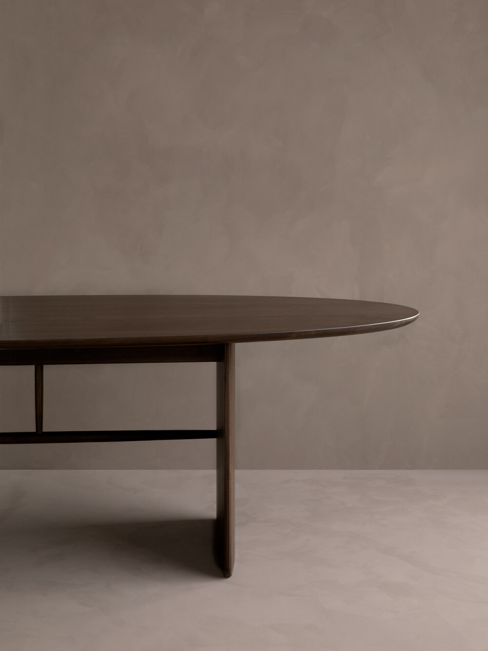 The Pennon table features a substantial table top contrasted with elegant spindle detailing.
