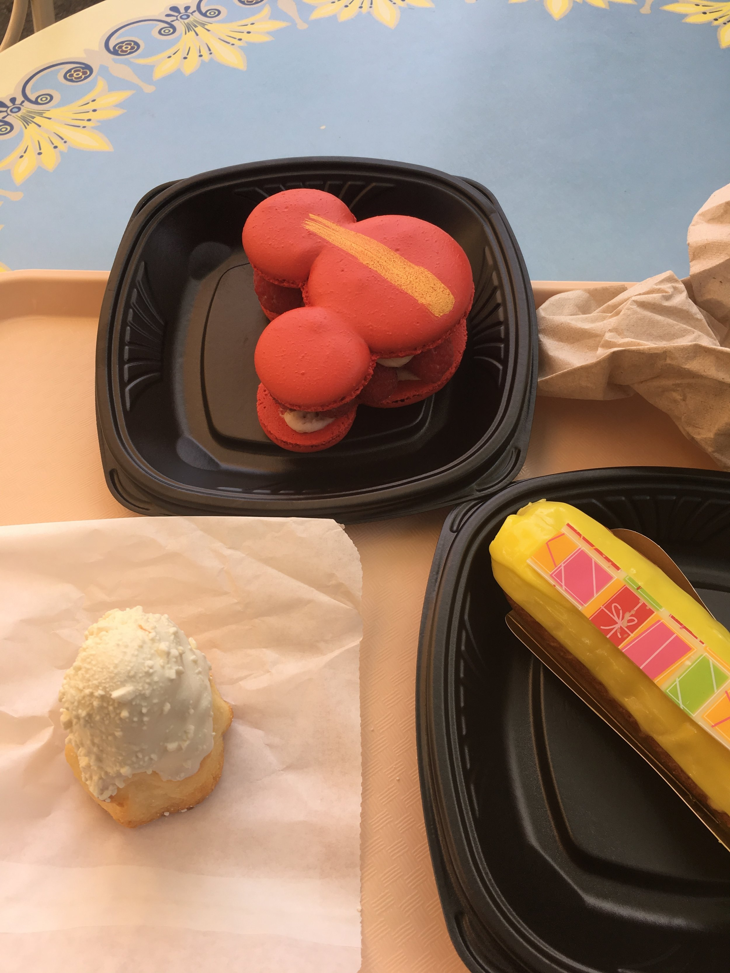 Jeez.  I really need to take a second to at least lay out things so they are not all caddywompus. Clockwise from bottom left- Matterhorn Macaroon, Raspberry Mickey Macaron, Lime(?) Eclair.  Somehow I lucked out and had the eclair pointing into the shot.