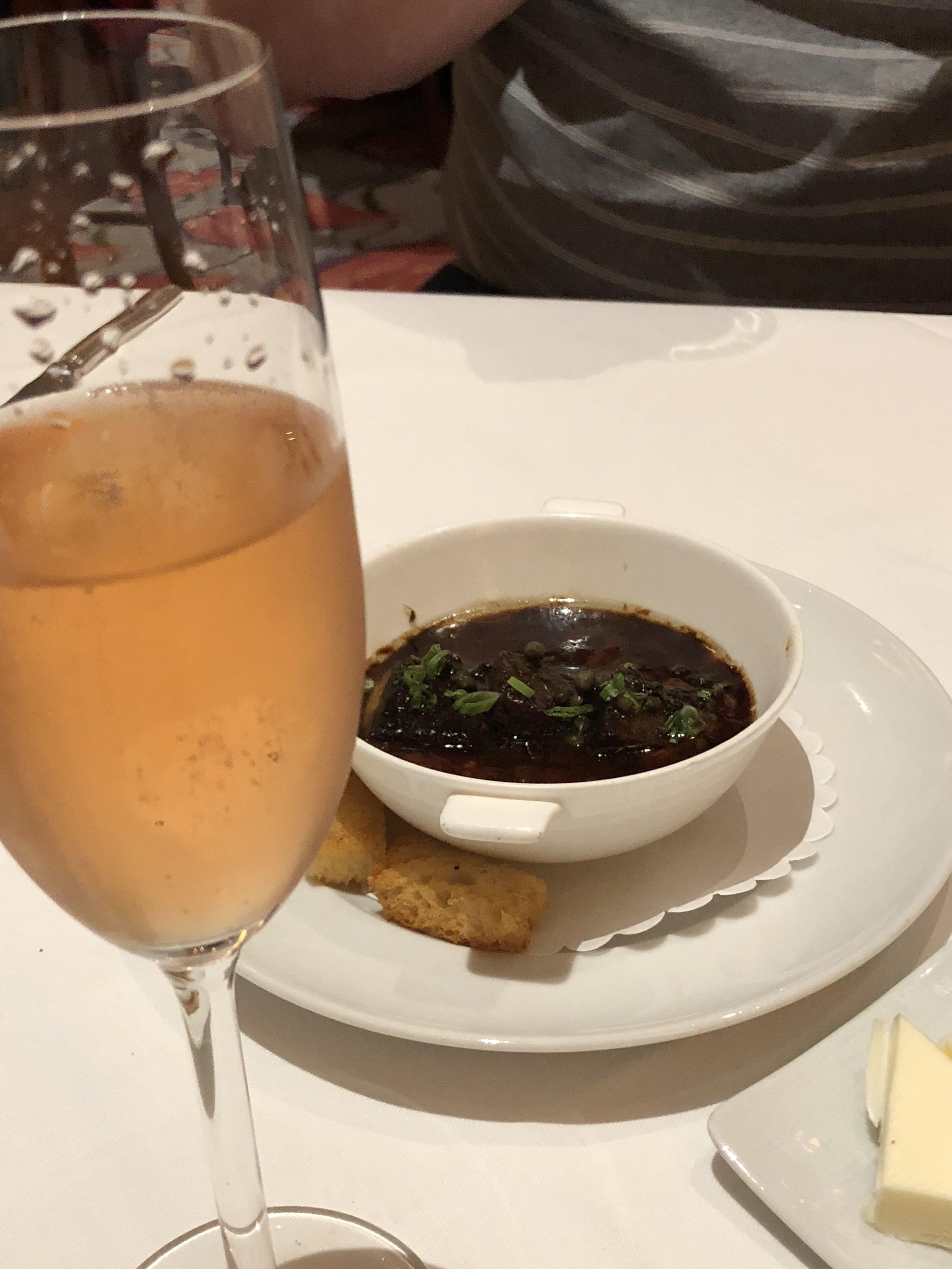 Warm Bone Marrow Custard with Braised Kobe Beef Cheeks, Capers, Orange Gremolata, and Sourdough Croutons,