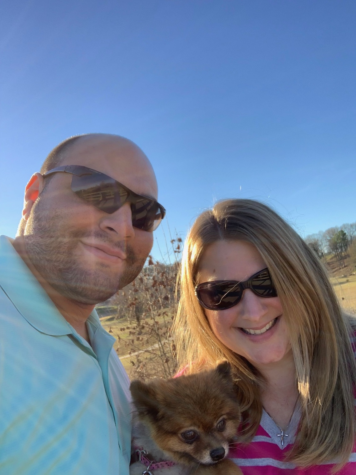 My husband and I with our Pomeranian, Daisy.