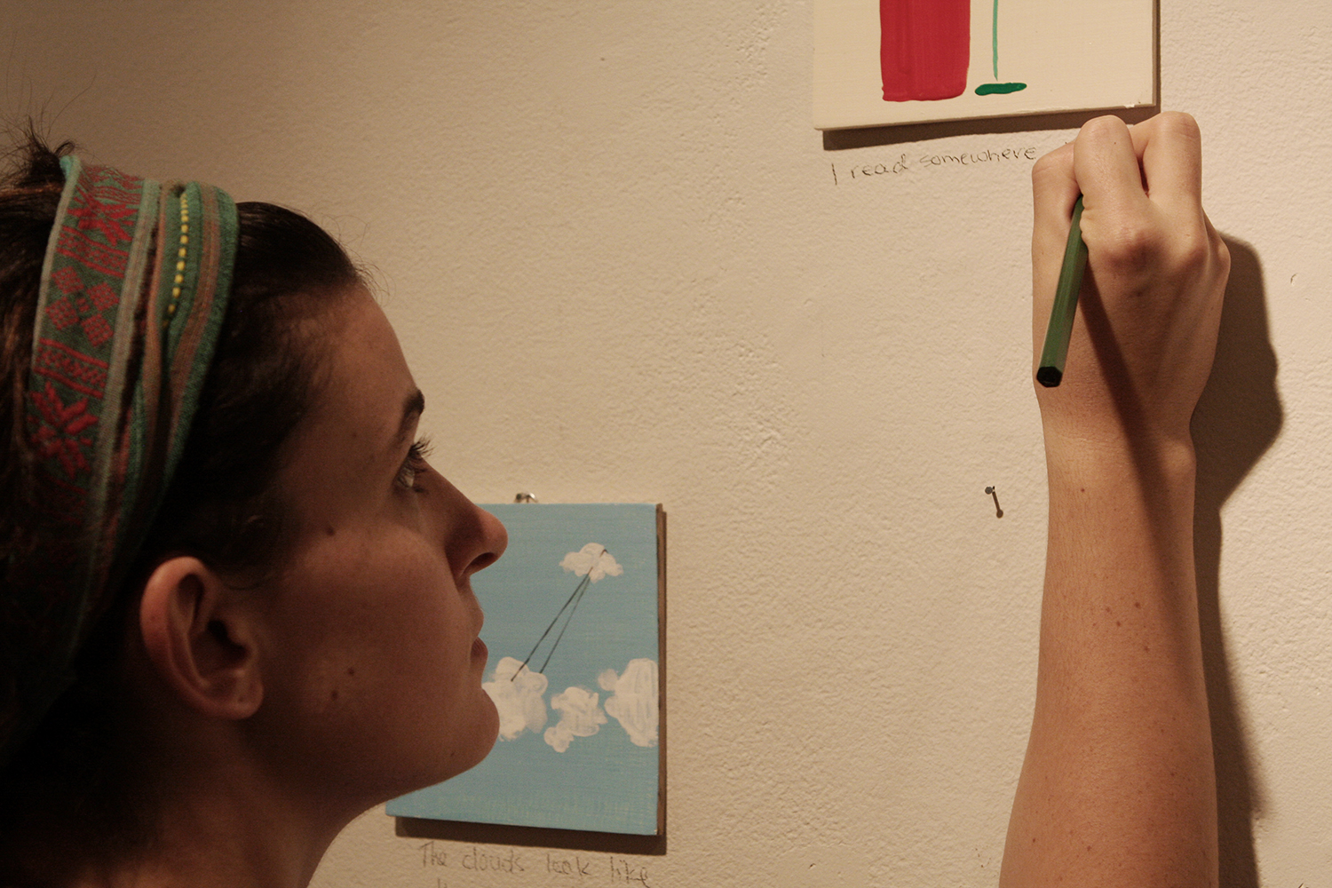 Today speak only in pictures , 2013, participant writing her submitted words under her painting