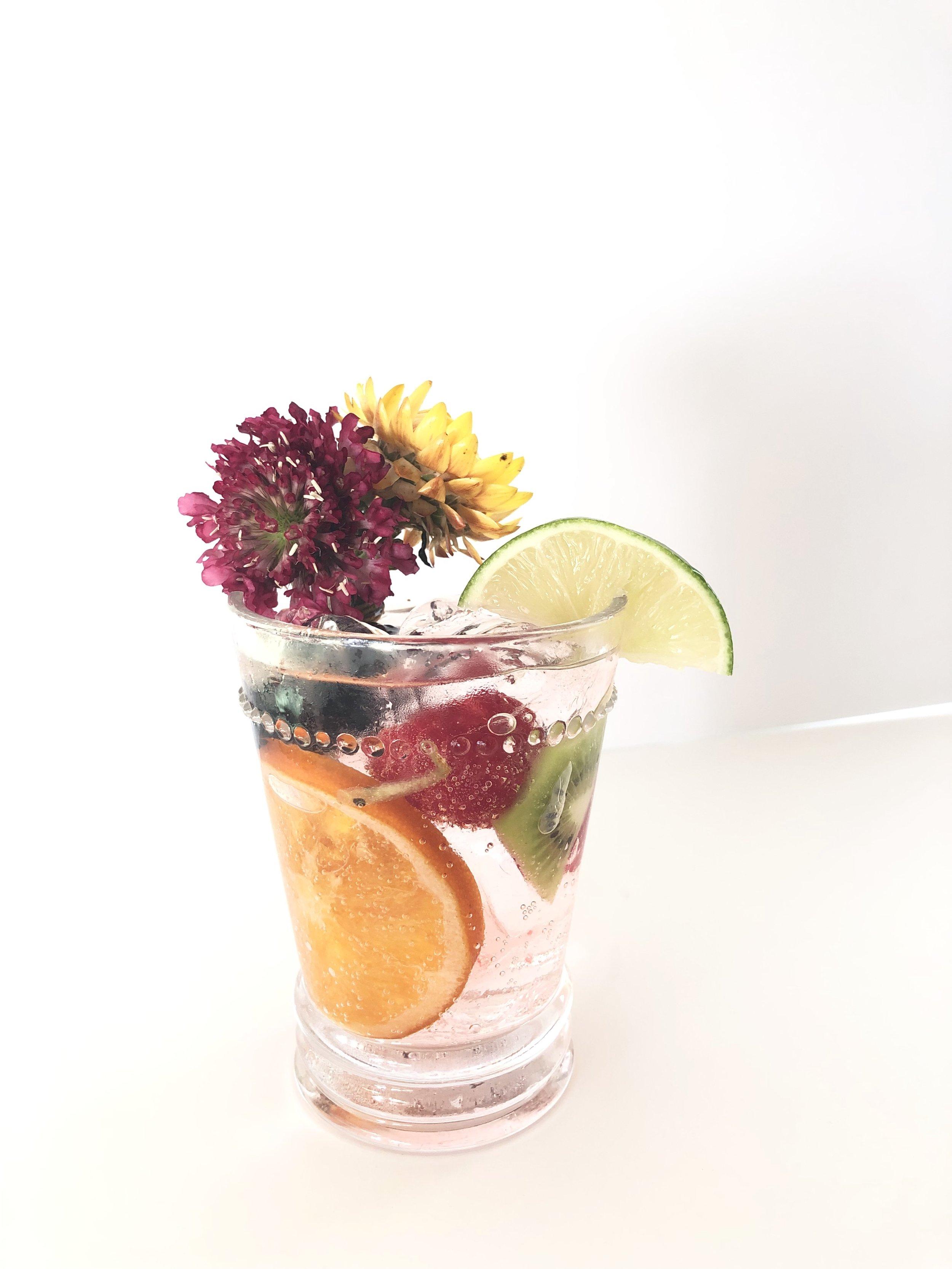Super Tonic - 2 1/2 oz Tito's VodkaFever-Tree Tonic WaterCombine Vodka and Tonic.Add:RaspberriesBlackberriesKiwiLimeCandied OrangeMuddle Dragon Fruit and Simple syrup. Add Gin. Shake Shake Shake. Strain. Add to glass. Top with tonic water.