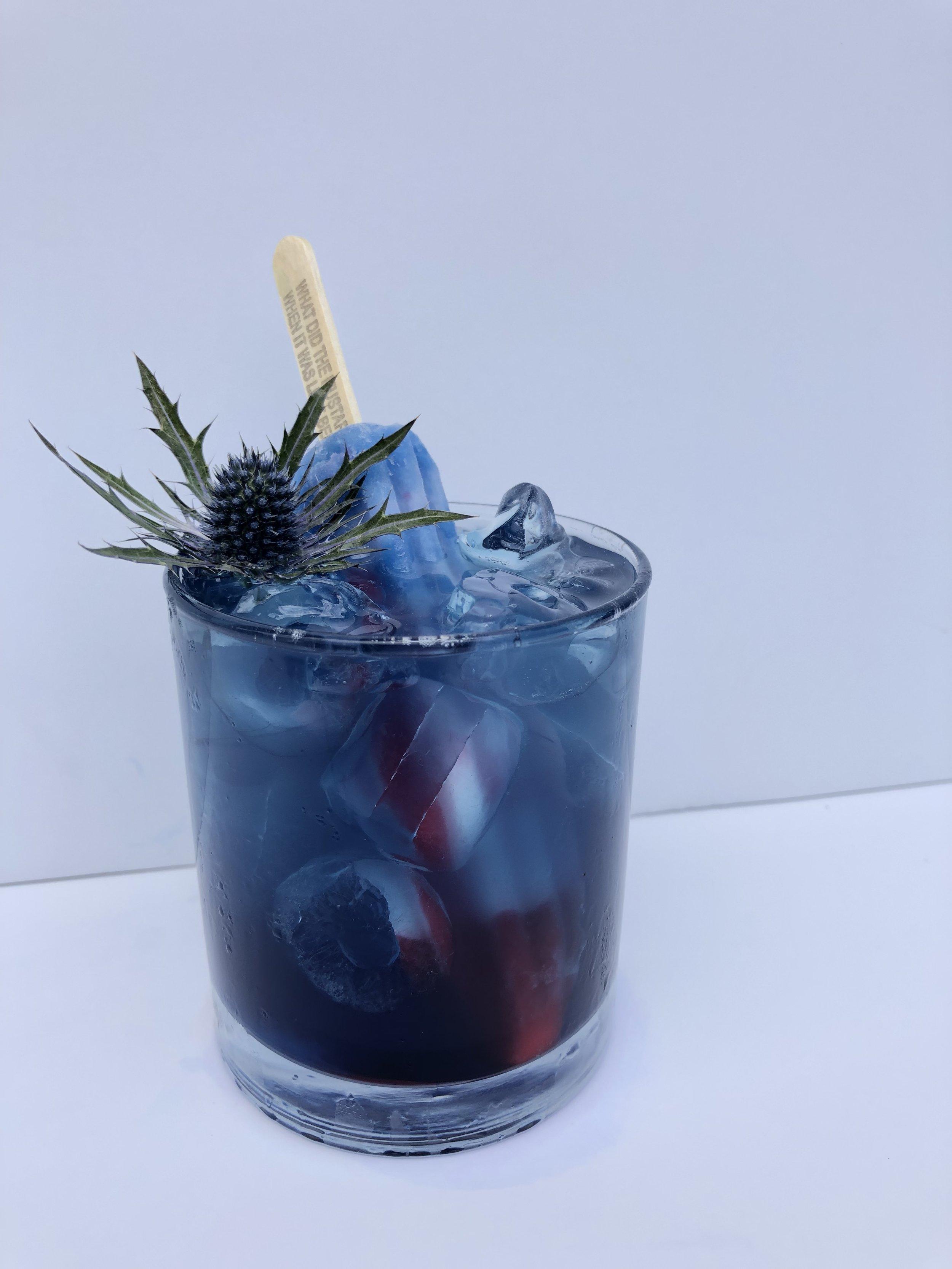 The Bomb.com - Splash of Blue Curacao2 1/2 oz BacardiTop with Cherry LemonadeServe over ice.Add Bomb Pop.