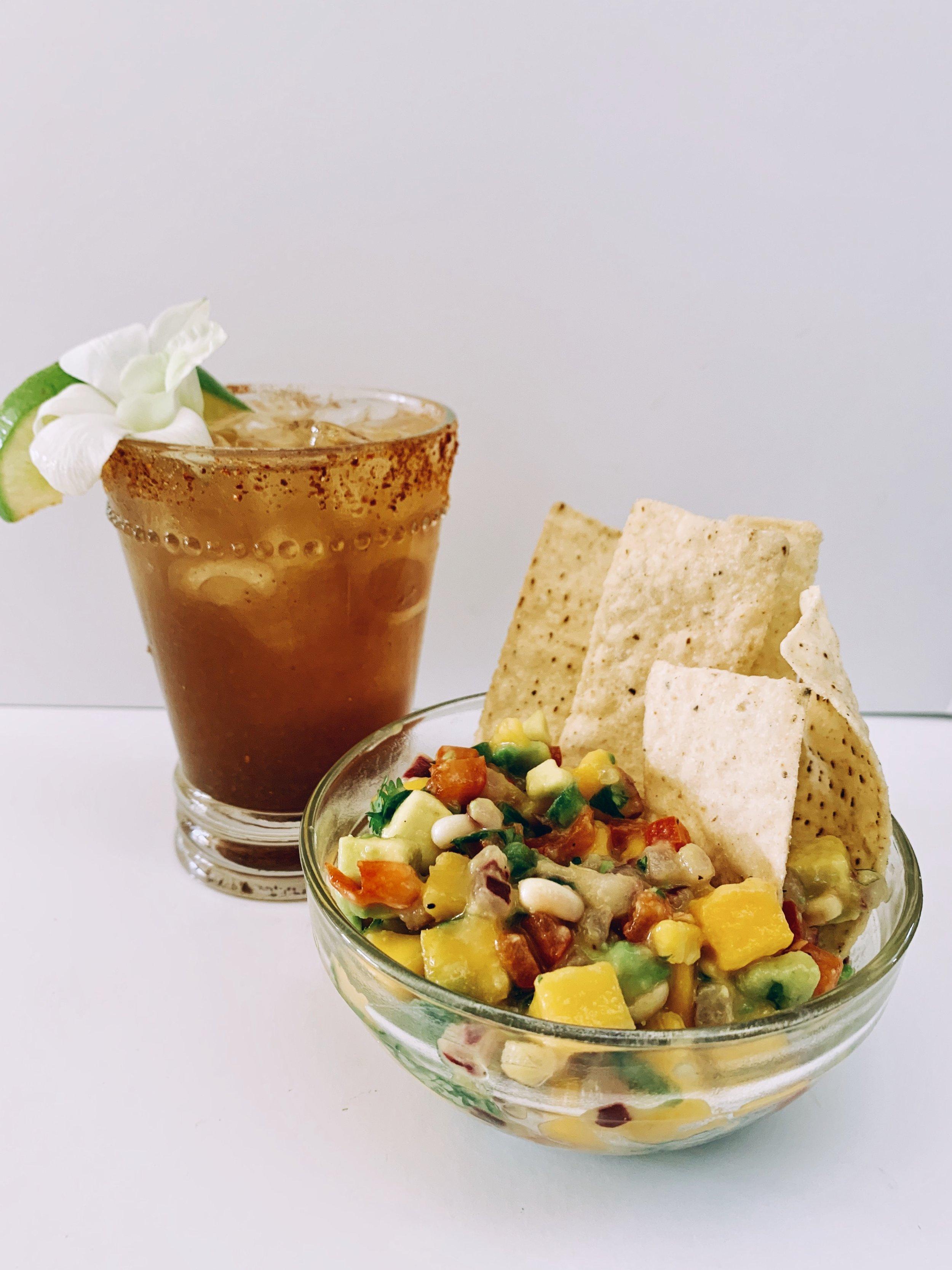Tamarind Margarita - 1 oz Lemon Juice1 oz Lime Juice1/4 tsp. Tamarind Paste2 oz TequilaDash of Sugar