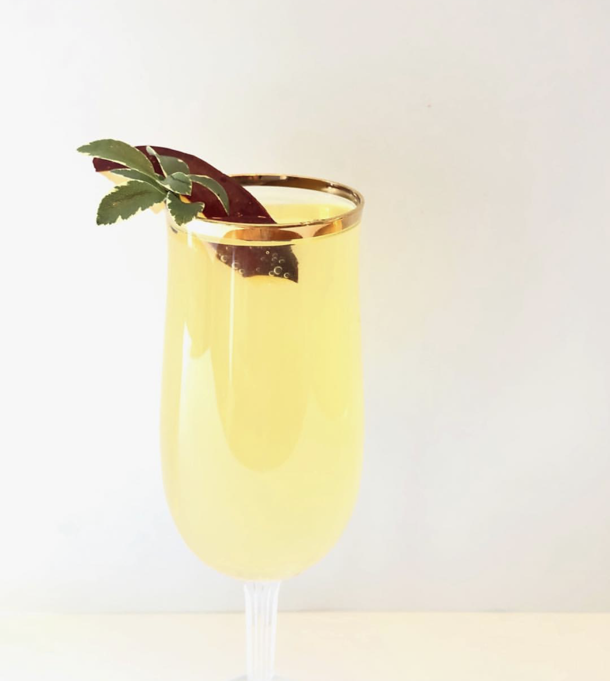 Plum Mimosa - 1/2 Plum- mashedA few sprigs of sage1 oz Saint GermaineShake it up! Add to glass.Top with Prosecco