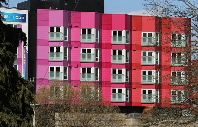 The recently completed Chroma apartments, at 1212 Harrison Street, offers 275 one- and two-bedroom units. The building, which is brightly painted in a rainbow of colors, is trying to entice renters by offering up... (Greg Gilbert/The Seattle Times)  By Mike Rosenberg