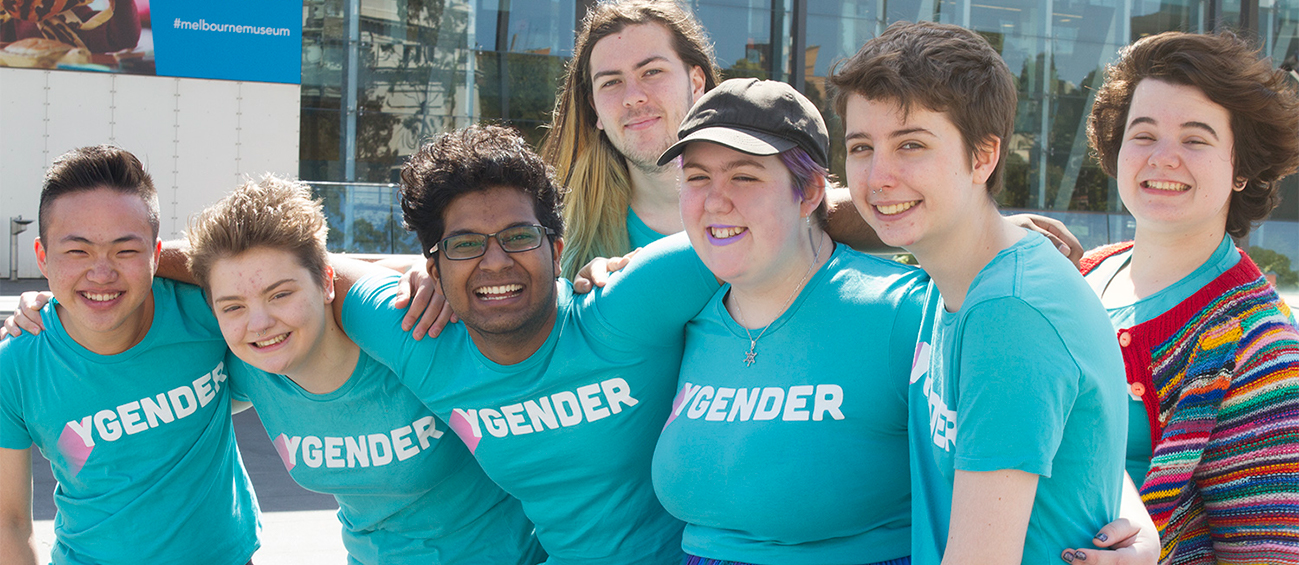 Seven young people in Ygender shirts