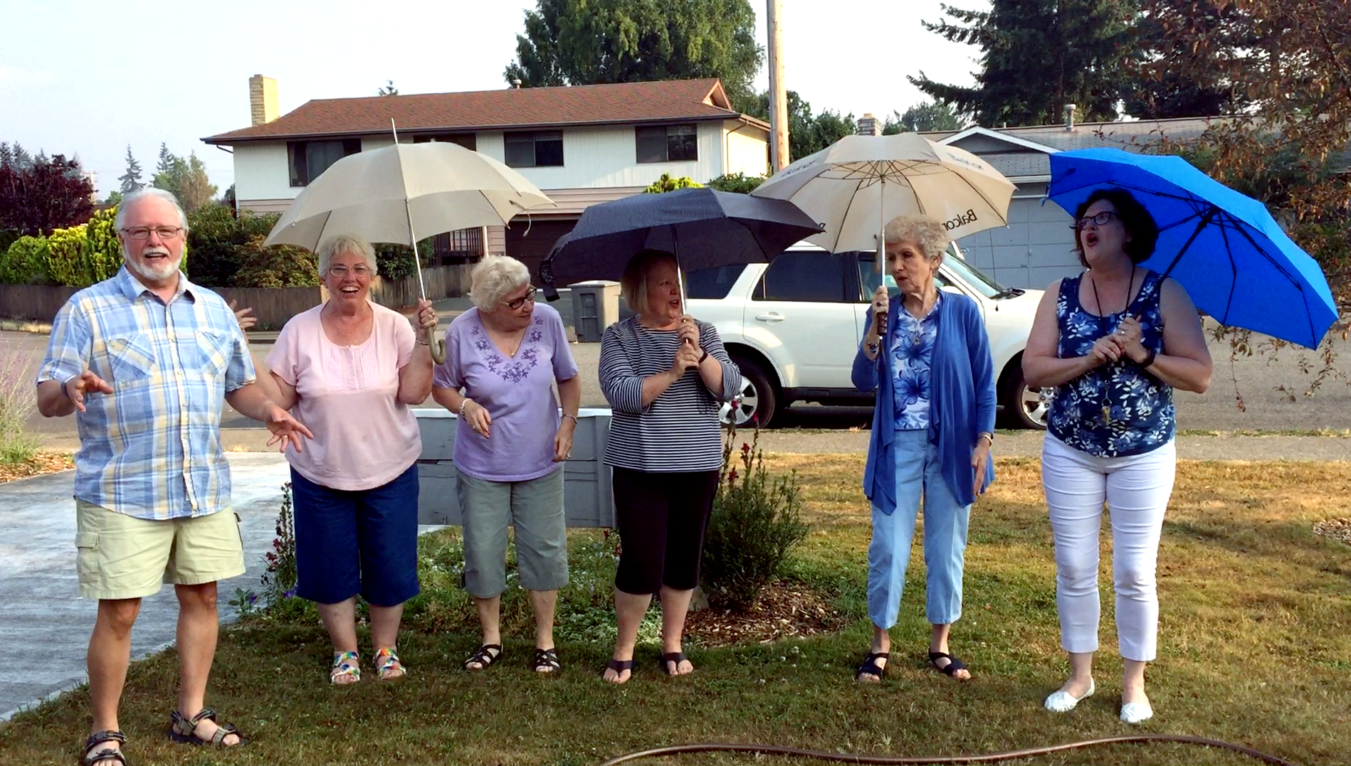 Everybody's mad. I'm mad. Even my sort of creeping fascination with what's happening in this country has slowed and resolved as anger. Charlottesville was clarity, if anything.  But my wife preached an awesome sermon this morning, and I can't stay mad forever. This picture helps. From our  Singing in the Rain night, as my wife (far right) led a group out to the front lawn of the church and played in the sprinkler, sang the title song, and just made the world a better place. I smile just looking at it.