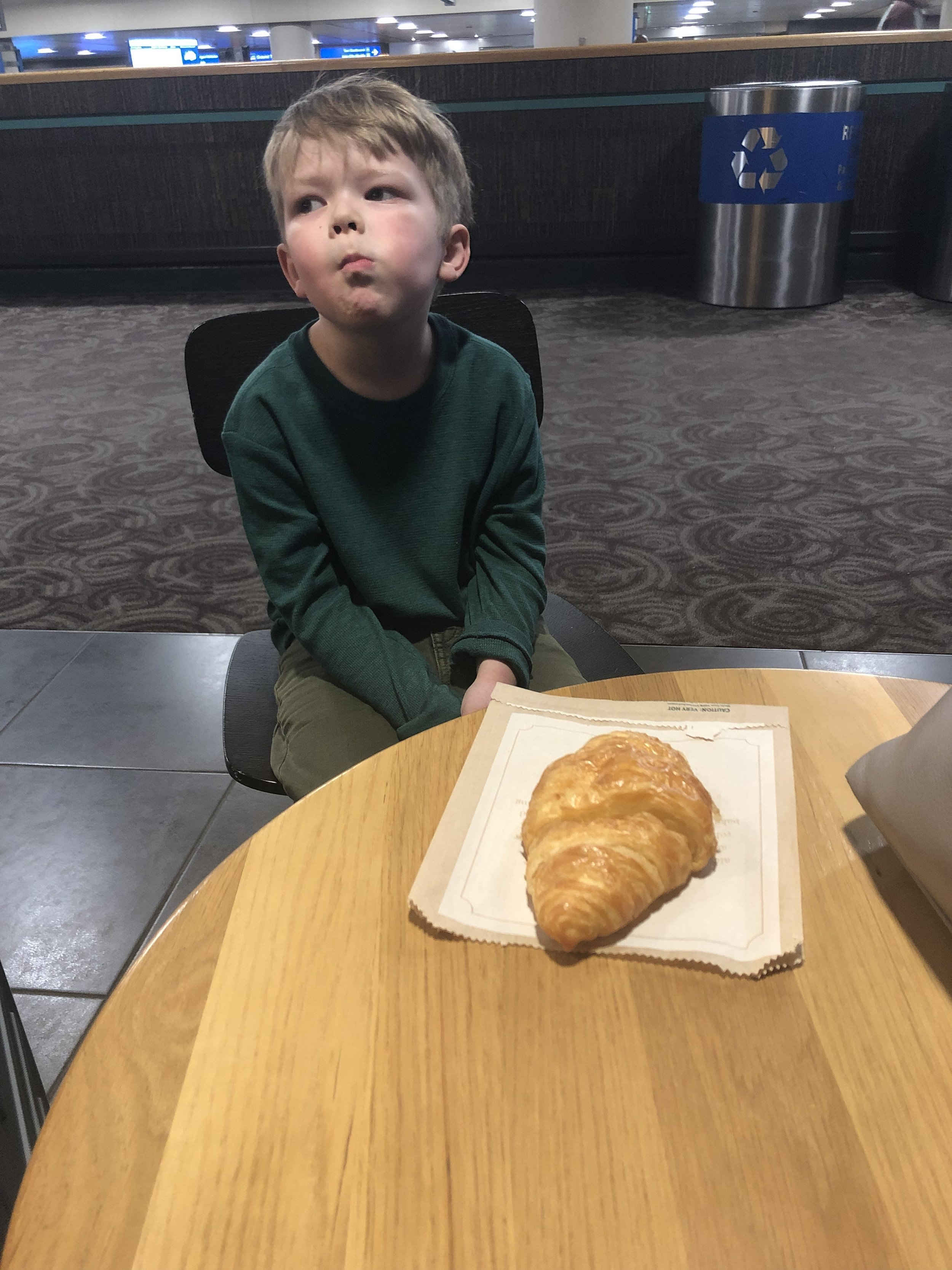 Airport Starbucks, and a croissant that would play an upcoming role.