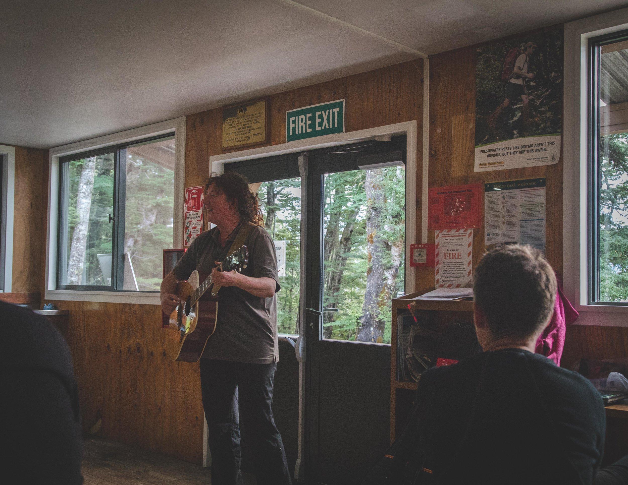 Rachel: the guitar playing hut warden at Moturau Hut on the Kepler Track