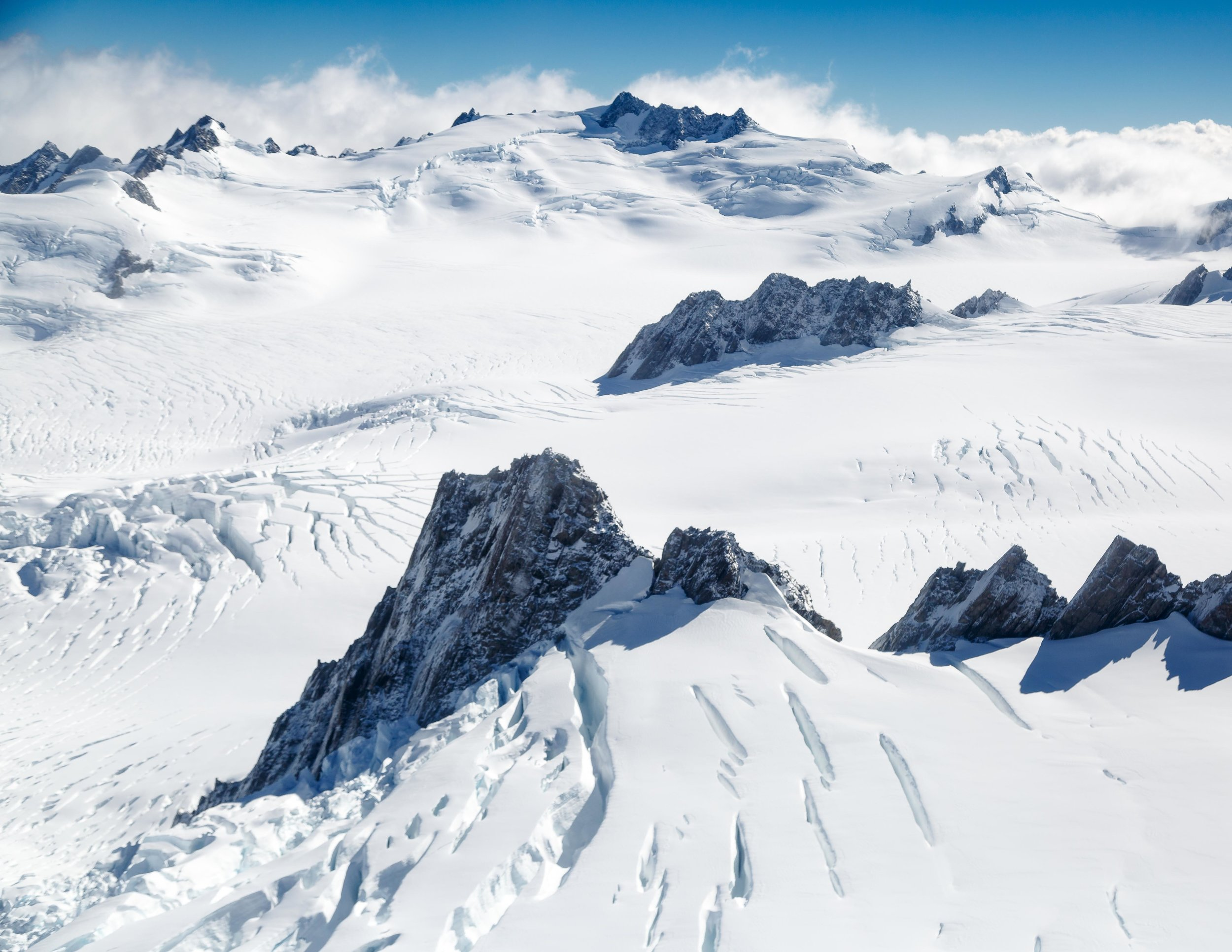 Flying over the glaciers at Fox Glacier and Franz Josef on a helicopter, New Zealand