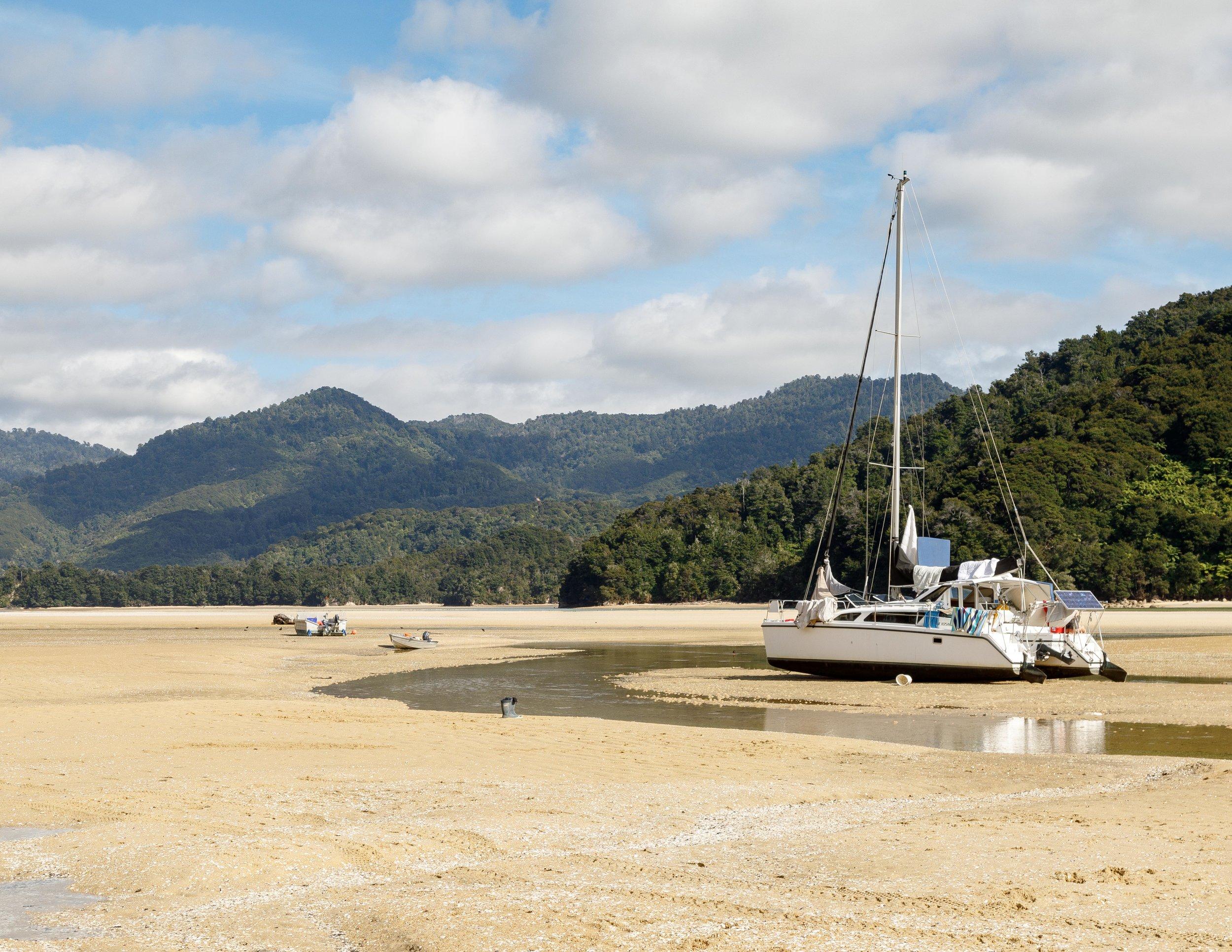 Beached boat at Awaroa Inlet, Abel Tasman Track