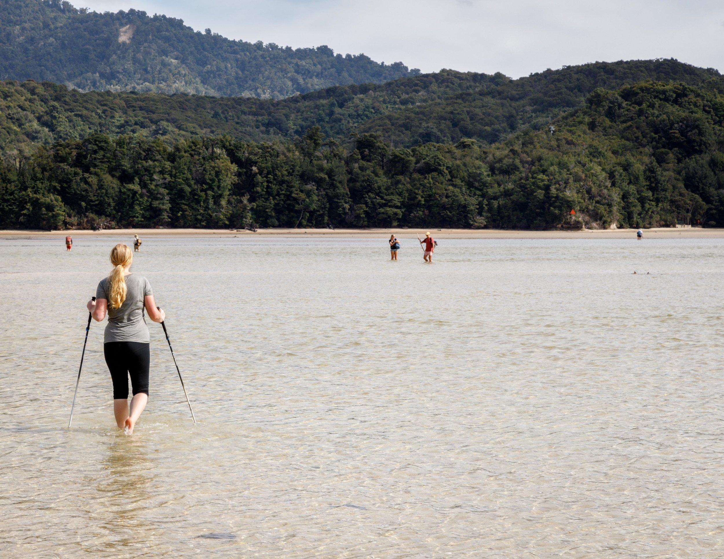 Wading across the Awaroa Inlet, Abel Tasman Track