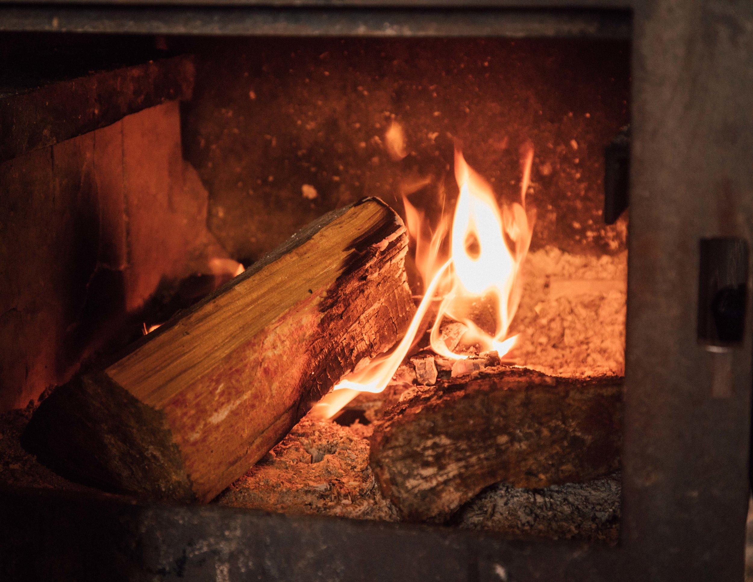Wood fire at Waiopaoa Hut, Lake Waikaremoana