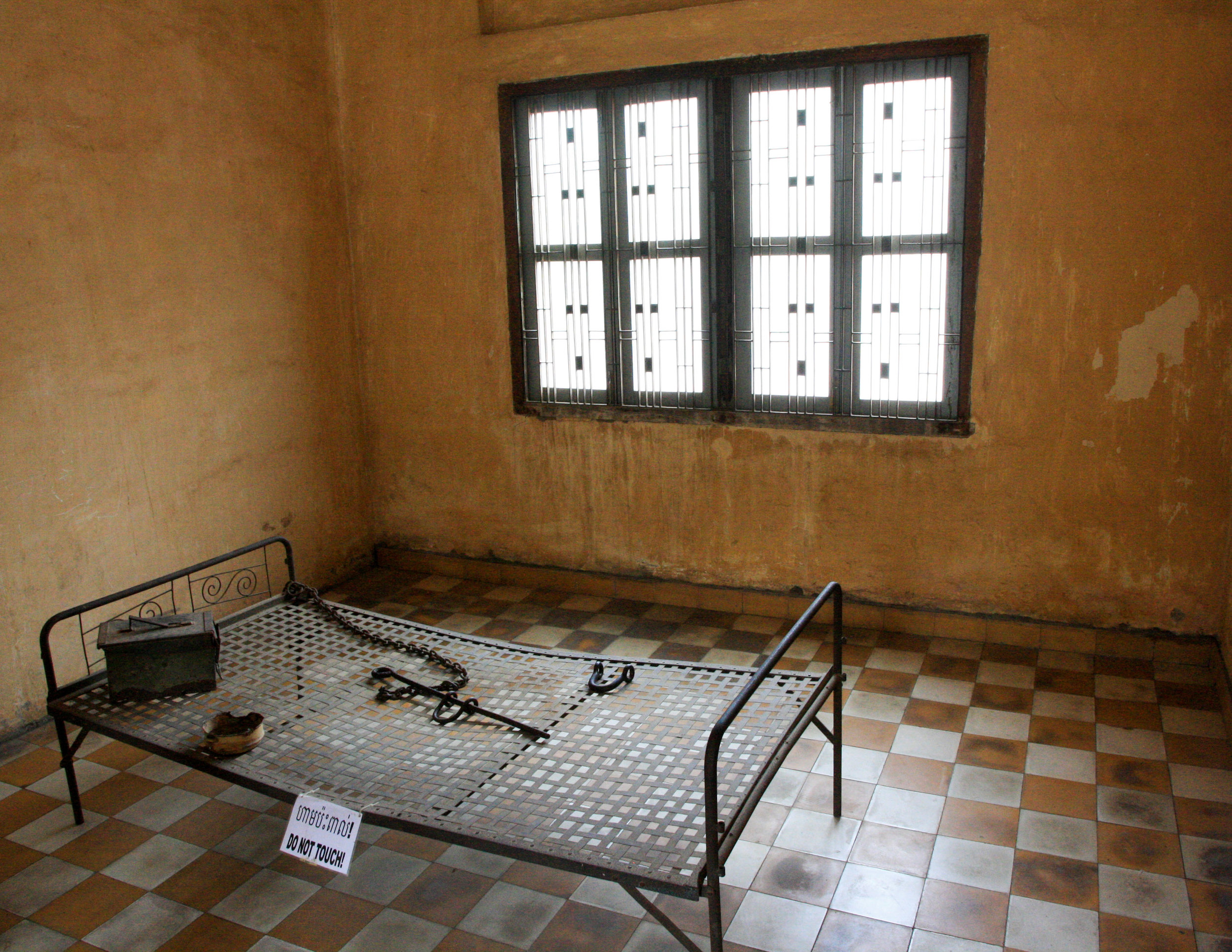 One of the prison cells at Tuol Sleng