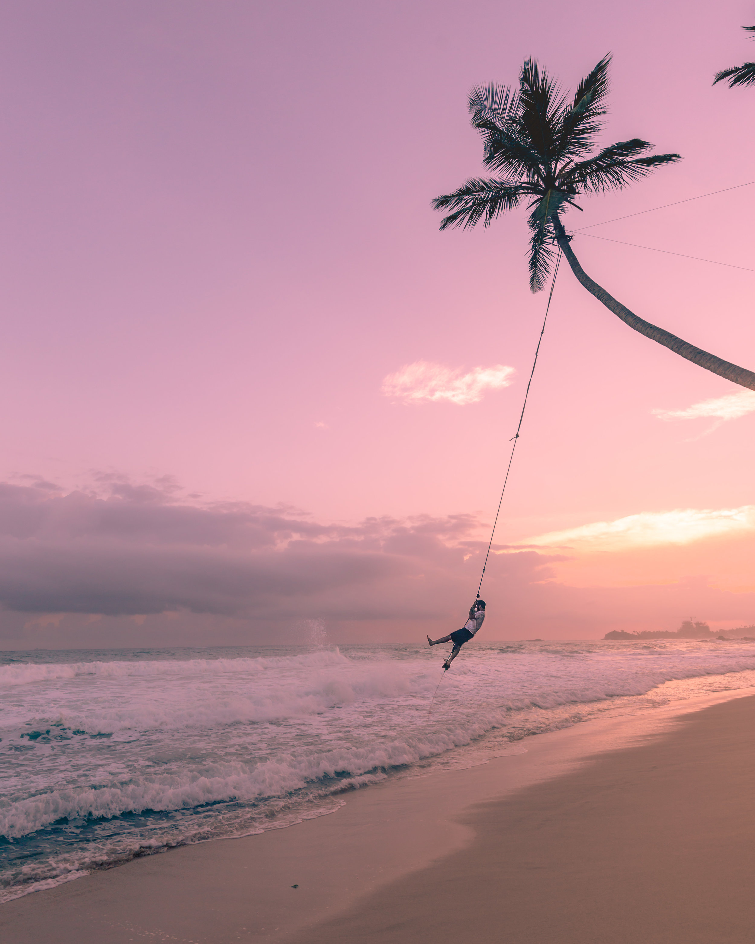 The rope swing at Dalawella Beach, Sri Lanka