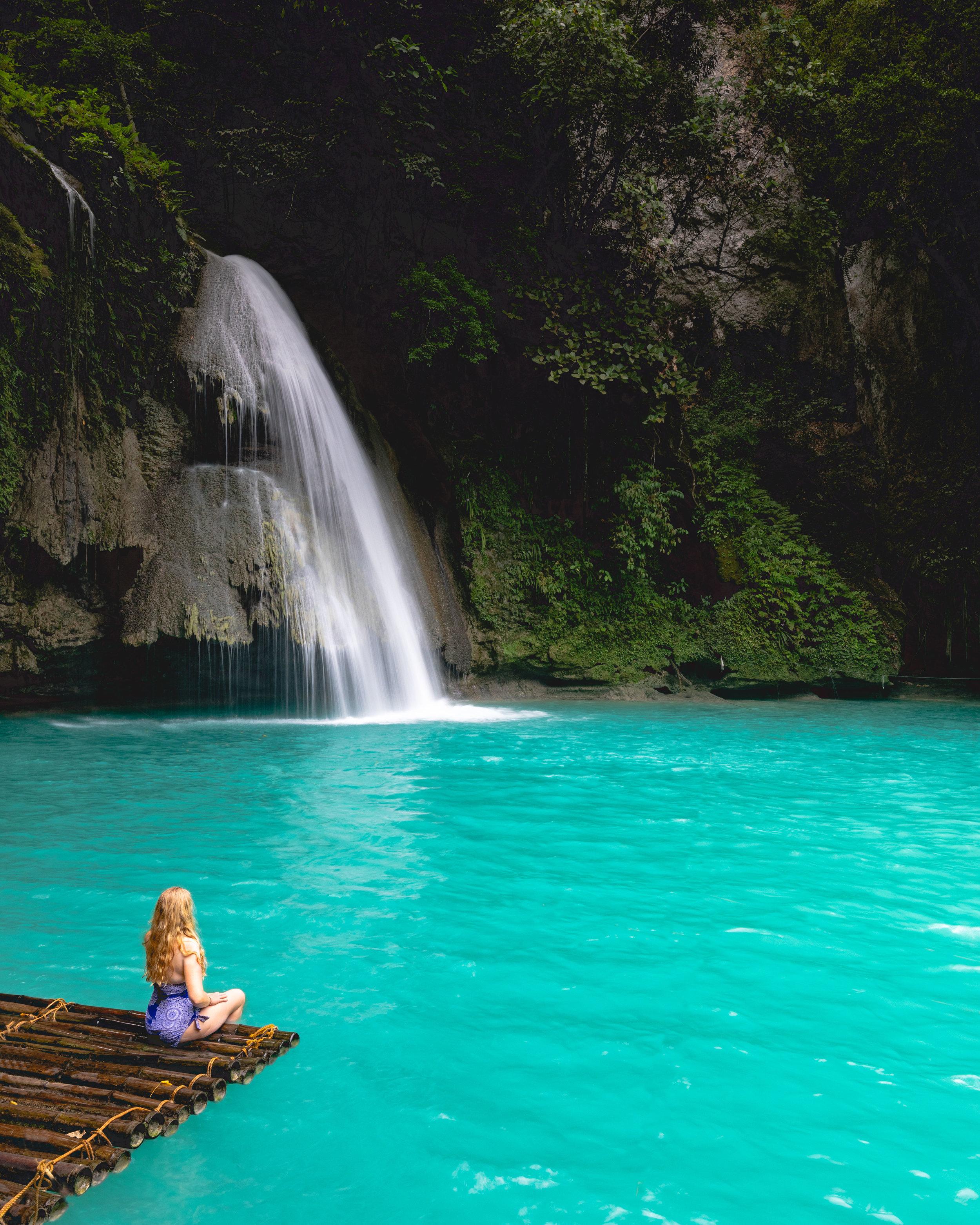 The bamboo raft at the bottom level of Kawasan Falls