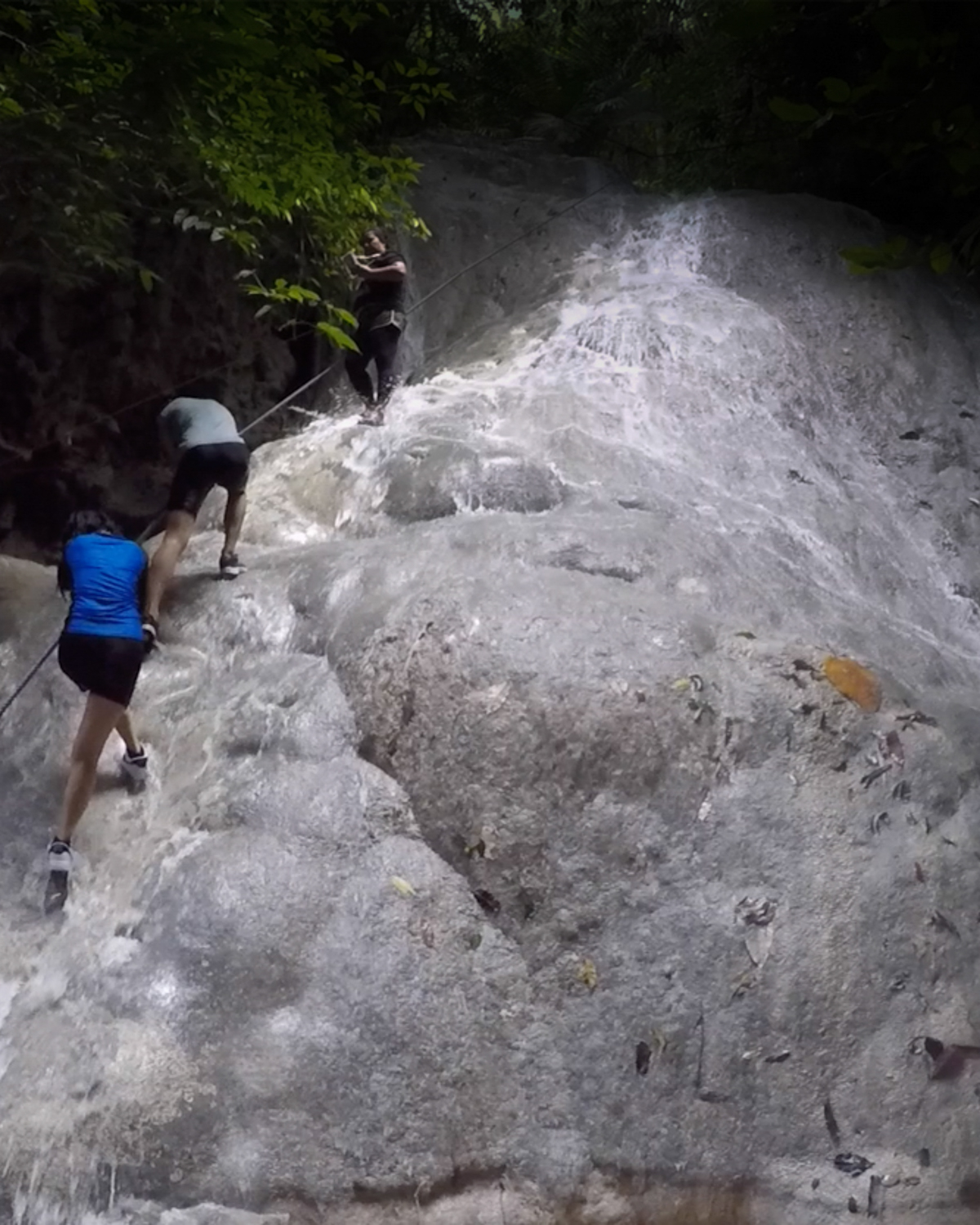 Climbing up the second falls in Aguinid