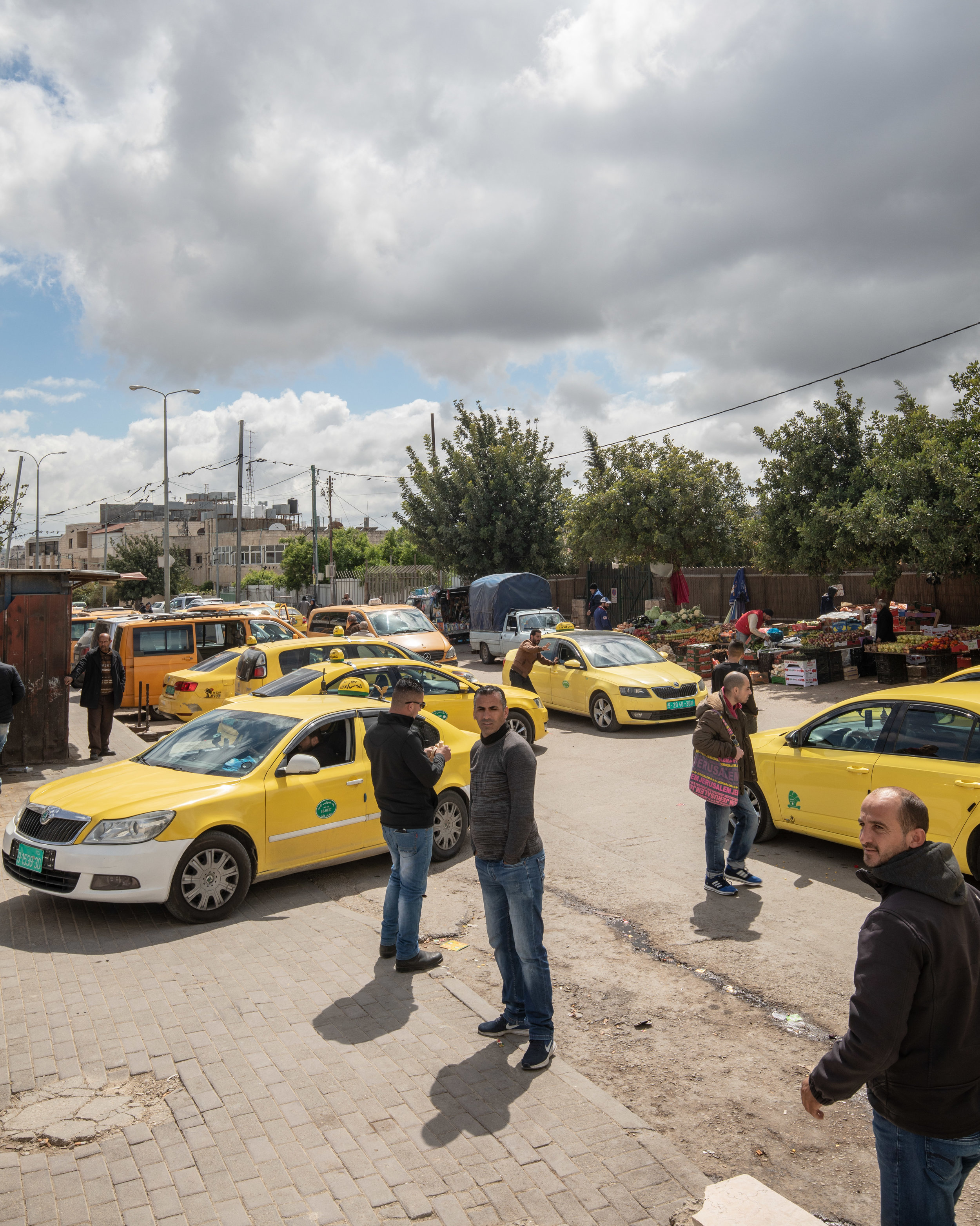 The taxi mafia at the border. Walk straight through and try not to engage any of them