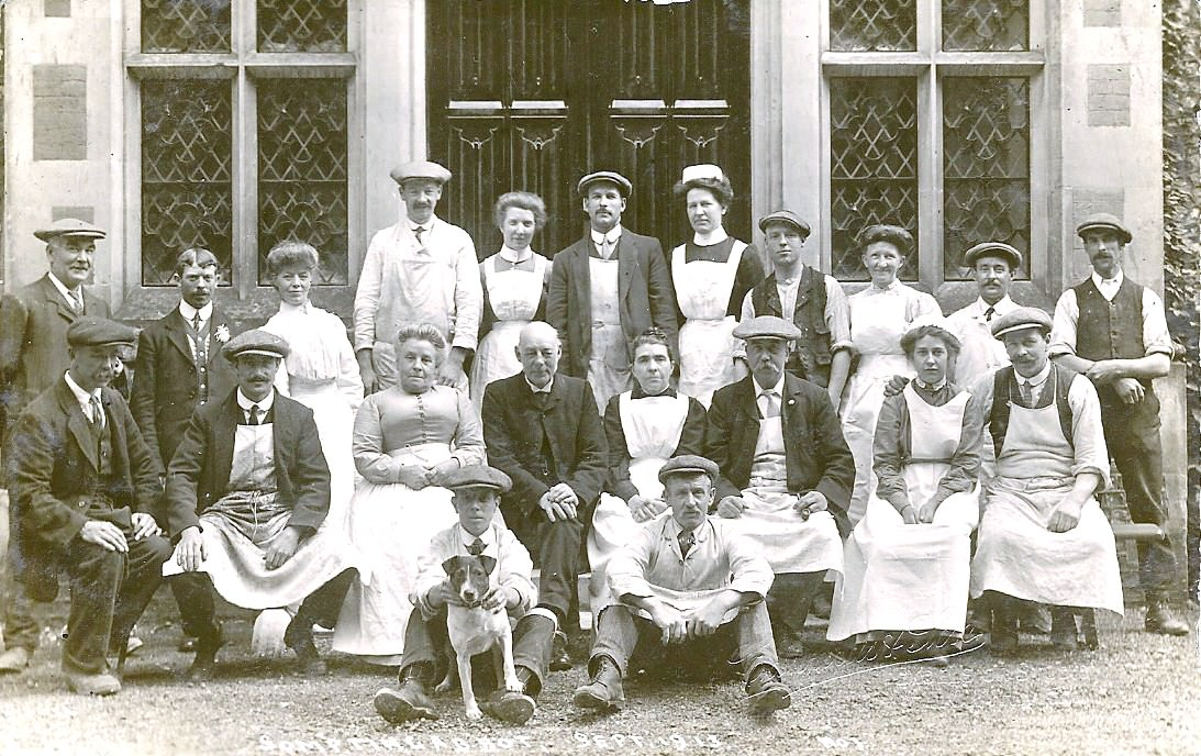 Staff at Sompting Abbotts - Do you recognise the immense entrance doors to the school? They've changed little since 1856.This picture, thought to date from 1913, shows the household staff. Like most manor houses of the time, Sompting Abbotts had an extensive staff.Photo credit: www.lancing-sompting-pastfinders.org.uk