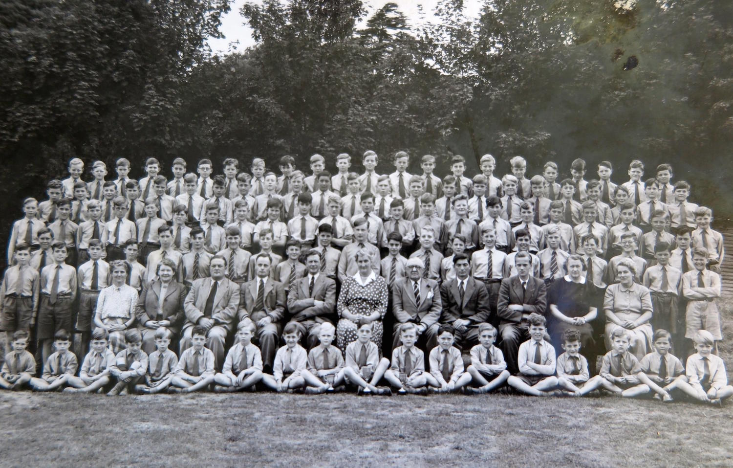 This undated school picture from the 1950s shows Molly Sinclair (centre in spotted dress) with Headmaster Mr George Rutherford to her right