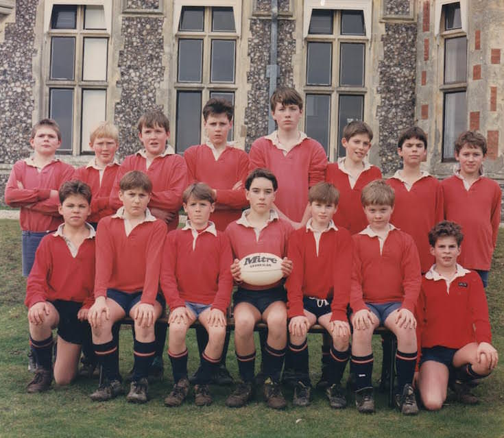 Alex, as a pupil at Sompting Abbotts, pictured centre with the rugby ball