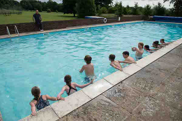 Children having swimming lessons in the outdoor heated pool at Sompting Abbotts