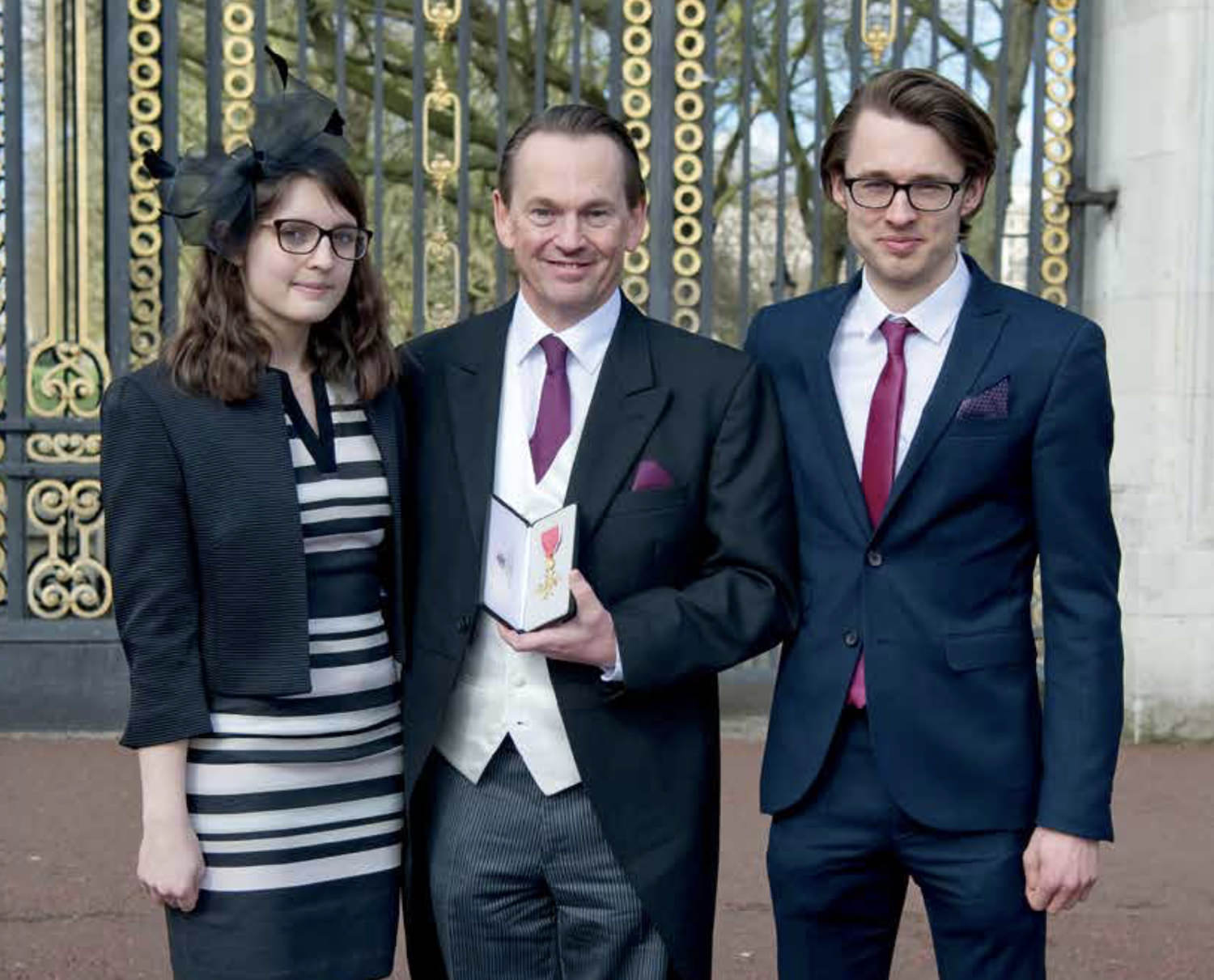 Former pupil Nick Linfield OBE, pictured here at Buckingham Palace with his children George and Molly, who also both attended West Sussex independent school, Sompting Abbotts Prep School. Like their father before them, they too are named on the school's scholarship Honours' Board