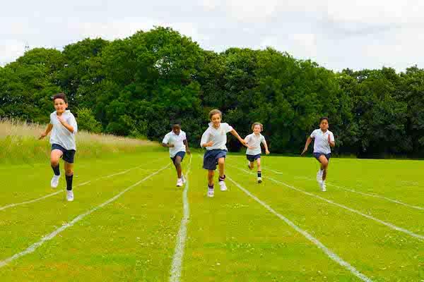 Children running the 100-metres at Sompting Abbotts
