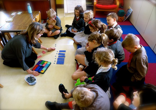 a small group of key stage 1 children learning maths at sompting abbotts independent school in sussex
