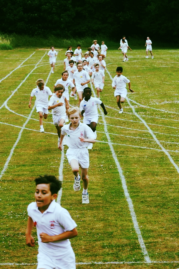At the annual Cross Country race at Sompting Abbotts, all children wear coloured ribbons to show their house membership