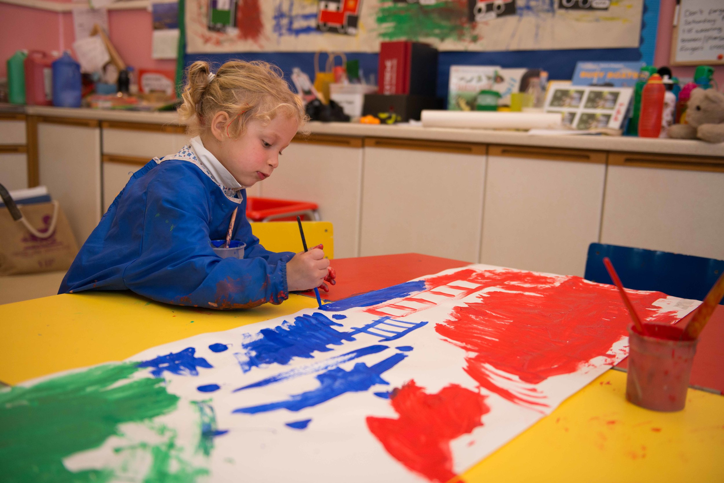 child painting in nursery at sompting abbotts