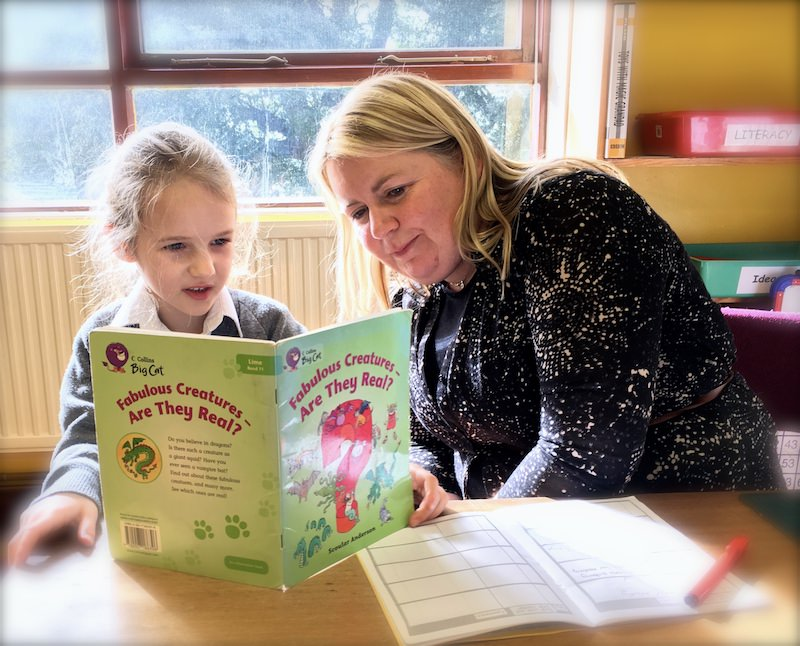 A child in Year 2 at Sompting Abbotts doing her daily reading with her teacher