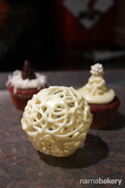 Experimented with the creation of white chocolate globes, many years ago, before it became a trend.