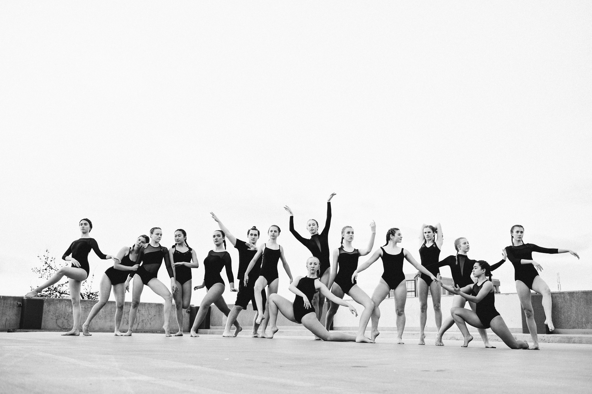 Competition Group Ballet - Photo Credit: Jay EadsFaculty: Caitlin ChristopherMembers Pictures: Grace Ault-Hanlon, Sydney Bineham, Devyn Boonstra, Autumn Dechter, Mayla Garlitz, Sesca Lindh-Nussbaum, Bronwyn Lord, Eloise McFarlane, Jessie McCann, Maggie McCann, Ady Walker, Sarah Dione, Lily Hansen, Savannah Lash, Allyssa Mini, Hanna Pavulans-Sherwood, Devan Strandburg, Sophie Raiskin Wood, Anna Philan, Gabriel Warren.This 60 min. ballet class is mandatory for all flex Studios competition group members. As one of flex Studios most advanced placement classes auditions and 4 years of previous training is required.Competition Group Ballet maintains an emphasis on proper vocabulary, body placement, technique, weight distribution, follow through, lines and facility. Attention is paid to the proper extension of the legs and shape of the feet, developing movement sequences, port de bras and balance. In addition, use of the head and upper body, fluidity of port de bras, and intricacies of petite and grand jumps will be covered. This class is paired as the precursor and warm up to the competition group choreography 90min class.Uniform RequirementsStaying with the tradition of ballet education and technique a mandatory uniform is required.Hair should be secured in a bun, up and off the face and neck.Dancers identifying as female wear black leotard, pink tights and pink ballet shoes.Dancers identifying as male wear fitted white dance tee shirt, black tights and black ballet shoes.Gender non-conforming or gender-questioning dancers should wear the dress requirements that makes them feel most comfortable.All body types welcome.