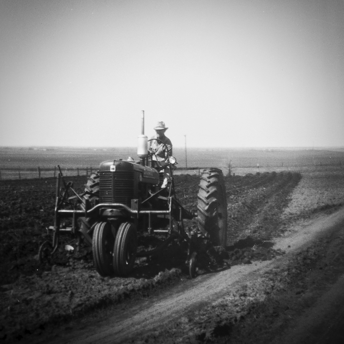 Farming technology at the time. My grandfather is driving the tractor. When he was born in 1891, radio was not yet a thing and the gas-powered automobile was a rarity only 6 years old. When my father died in 1981, he was still using that old tractor.