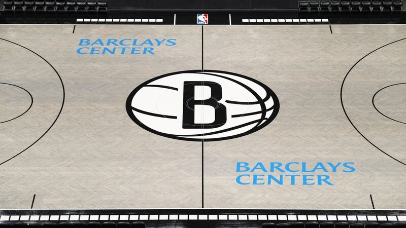The logo in the center of the floor has been simplified, losing the city and state wordmarks which previously adorned it. (Mike Lawrence/@mikelawrencesport)