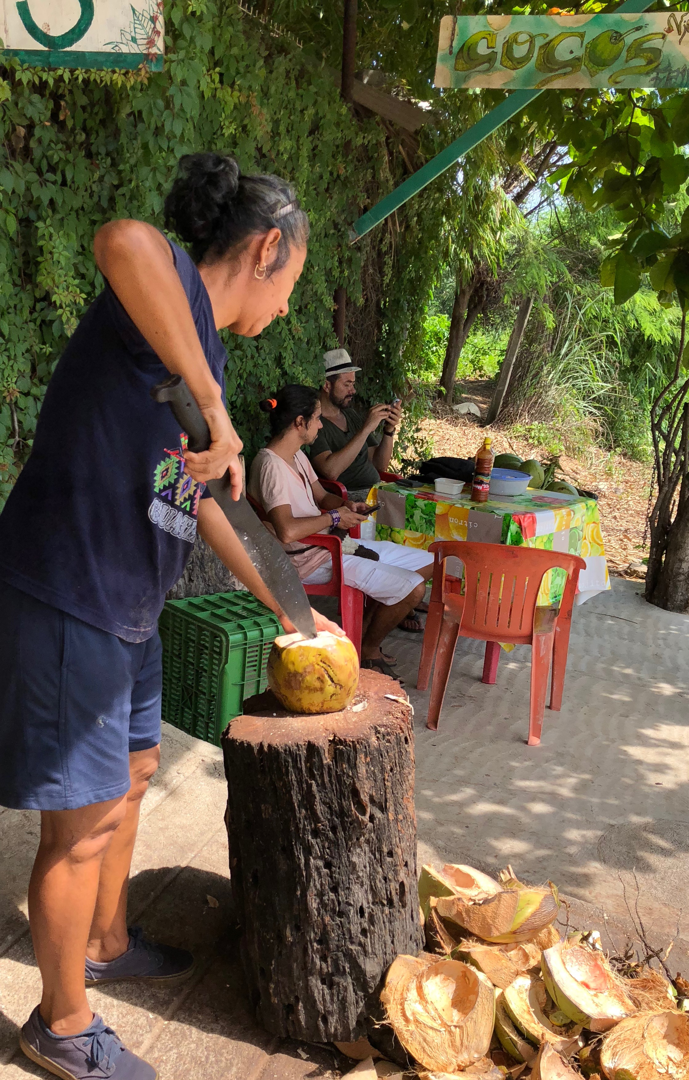 Don't try this at home! Ninfa has decades of practice with her huge Machete. She is a master in the art of coconut slicing.