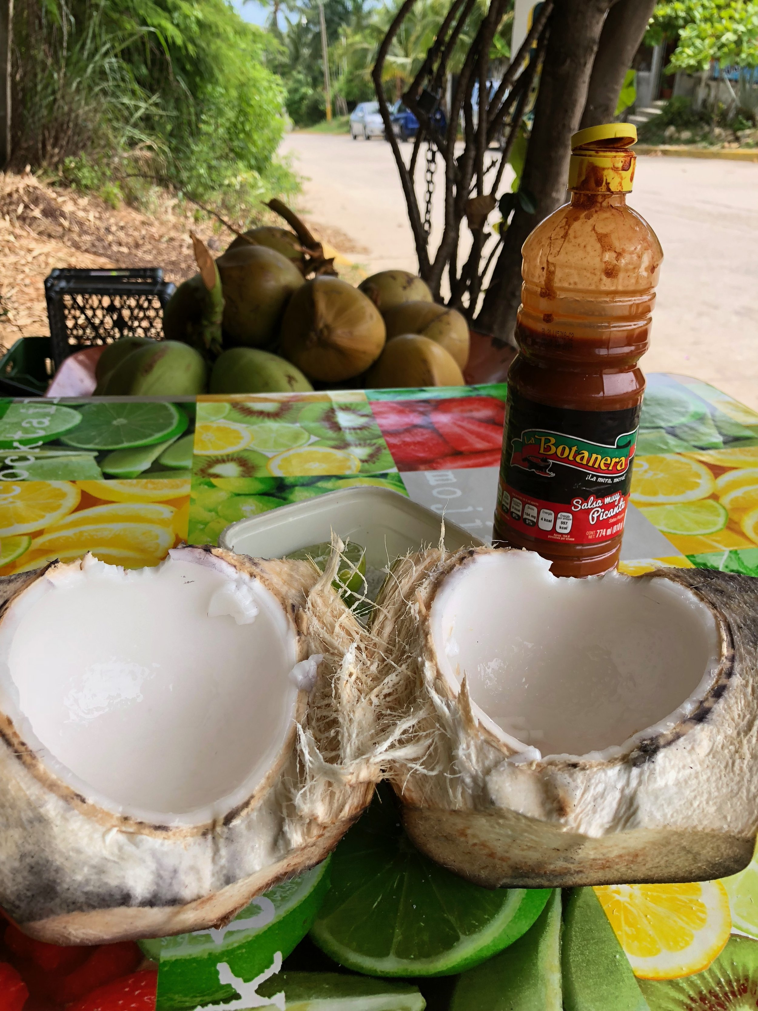 Hot sauce, lime and salt are optional but add an interesting element to the soft coconut meat usually eaten with a spoon.