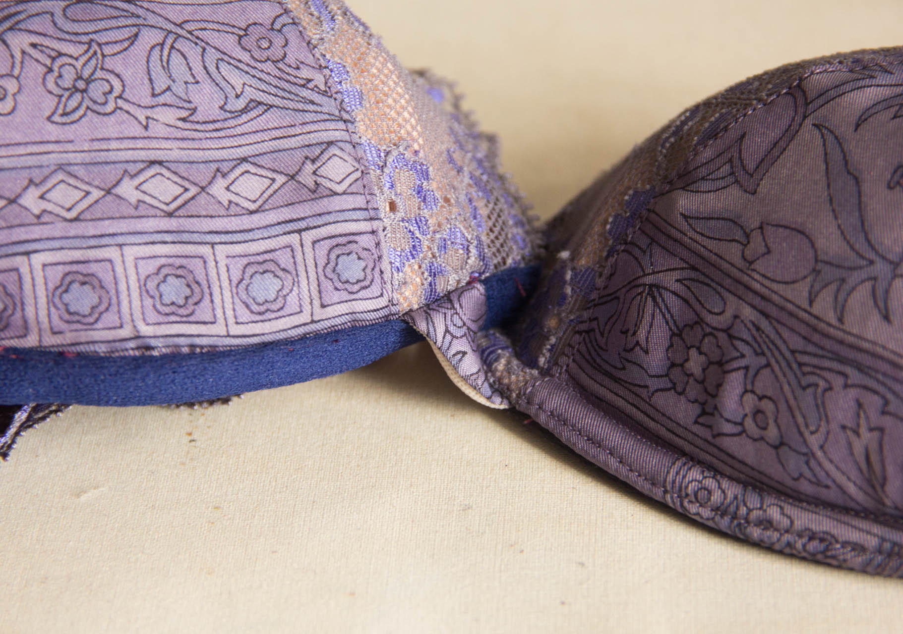 On the right, the cup topstitched with two rows of stitching, which holds the channelling under the cup. On the left, the channelling is attached but not yet topstitched.