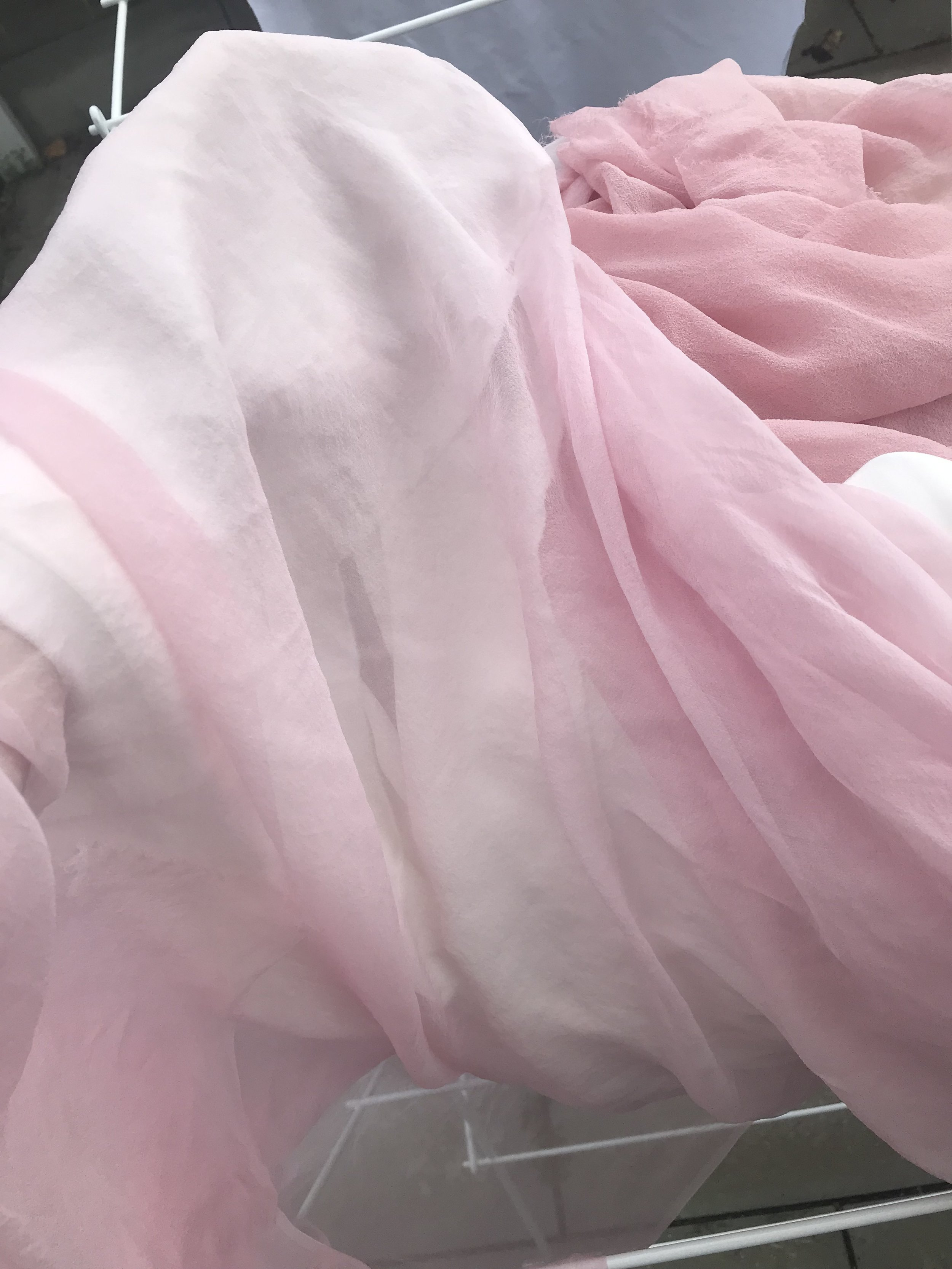 This is the first gauze (middle dress layer) over the white silk satin before dyeing. the too-pink chiffon is in the background.